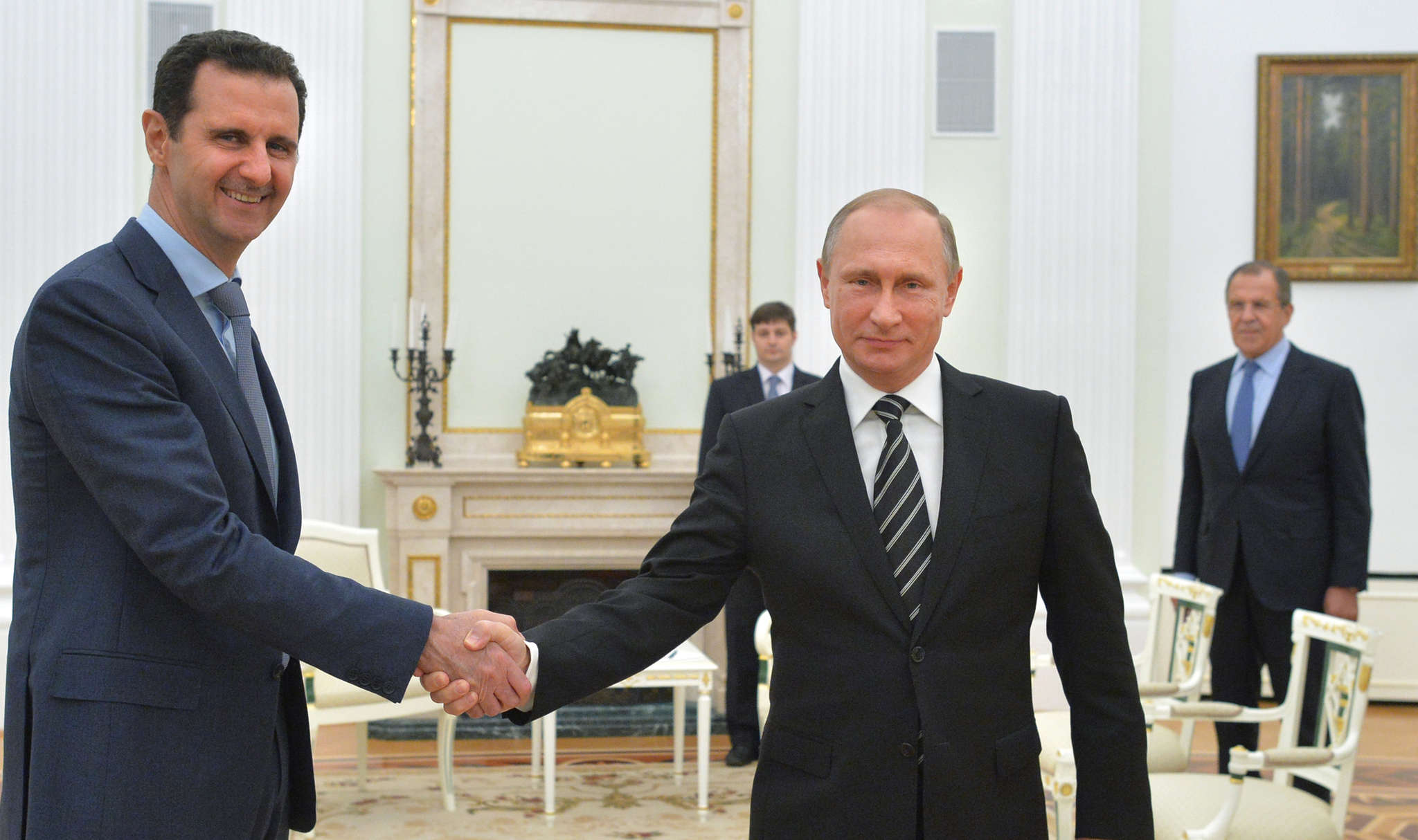 Syrian President Bashar al-Assad (left) shakes hands with Russian President Vladimir Putin, who boosted his support for Assad last year with airstrikes.