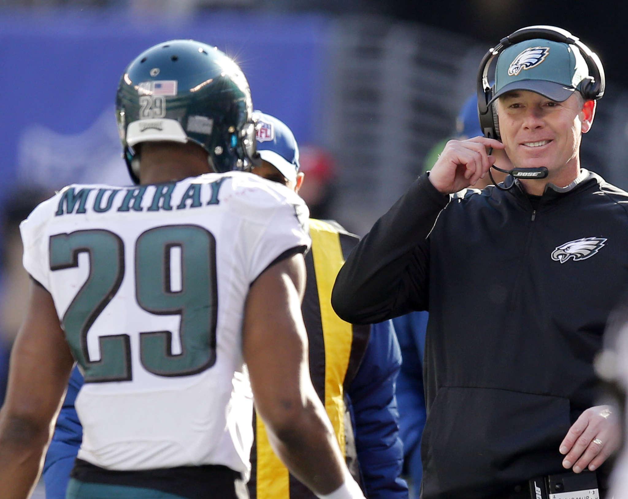 Pat Shurmur greets DeMarco Murray after 54-yard touchdown run on Shurmur´s fifth play as Eagles interim coach. YONG KIM / STAFF PHOTOGRAPHER