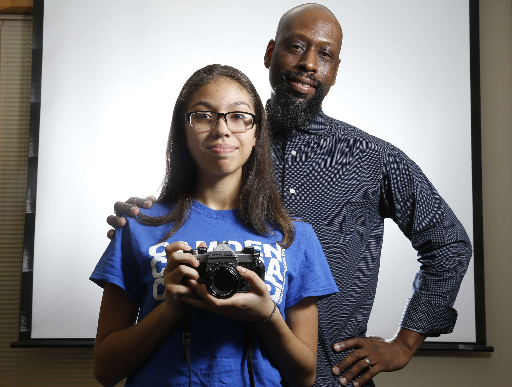 "Rivera poses with her teacher, professional photographer Erik James Montgomery. Her mentor of two years says Rivera is ""such a great young photographer, I keep extending"" her instructional time."
