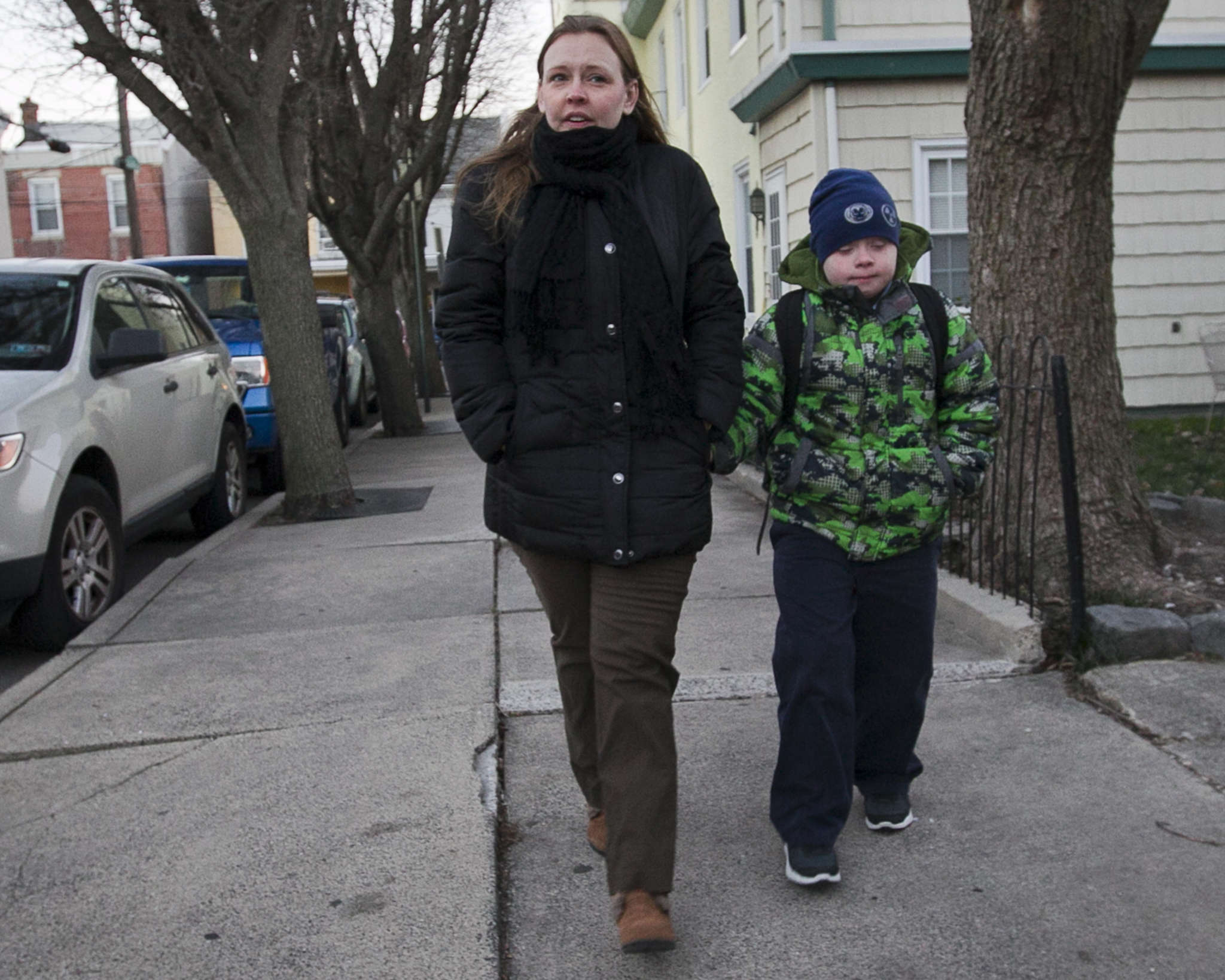 "Monica Klimas and son Danny Gallagher near their home in Bridesburg: Once, Danny didn´t get home until 5:30 p.m. ""His day was longer than mine,"" says mom. ALEJANDRO A. ALVAREZ / STAFF PHOTOGRAPHER"