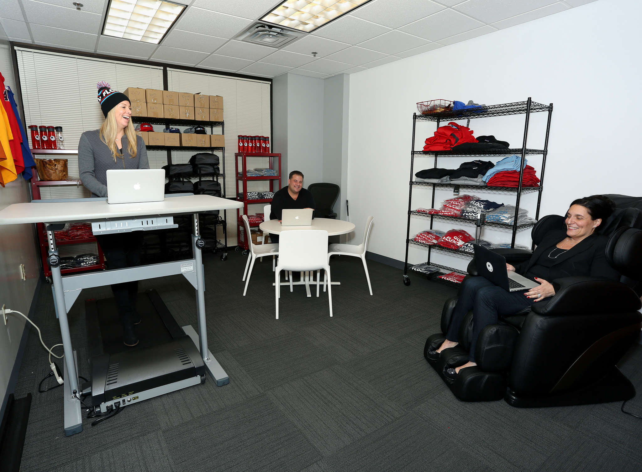 Caroline Weller (left), Josh Verne, and Zanny Oltman in FlockU´s King of Prussia headquarters. FlockU has tried to millennialize its space in an unremarkable-looking building in a suburban office park with open work stations, a treadmill, and a massage chair.