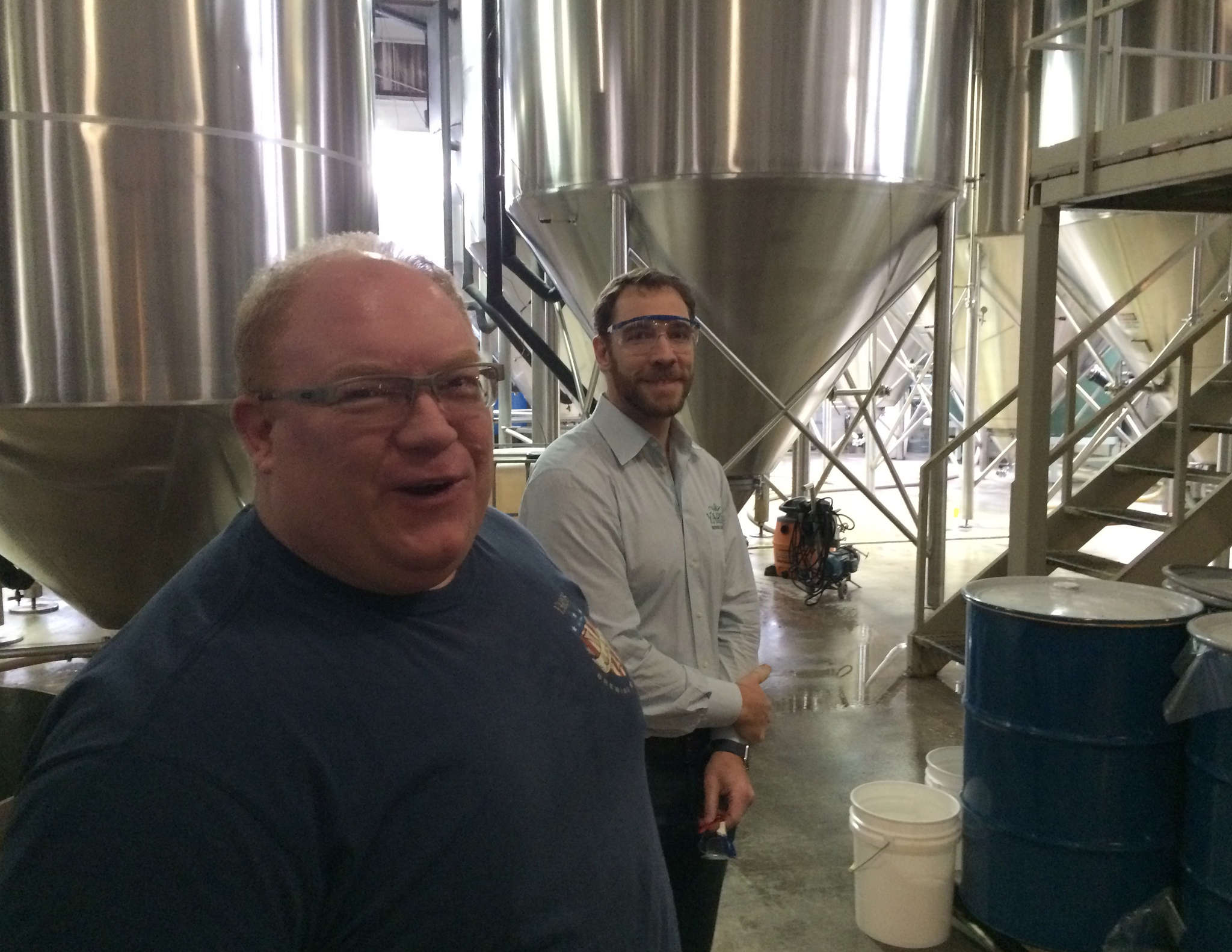 Yards Brewing president Tom Kehoe (left) and chief operating officer Trevor Prichett at their plant in Northern Liberties. Yards hopes to move, if it can find space near Center City.