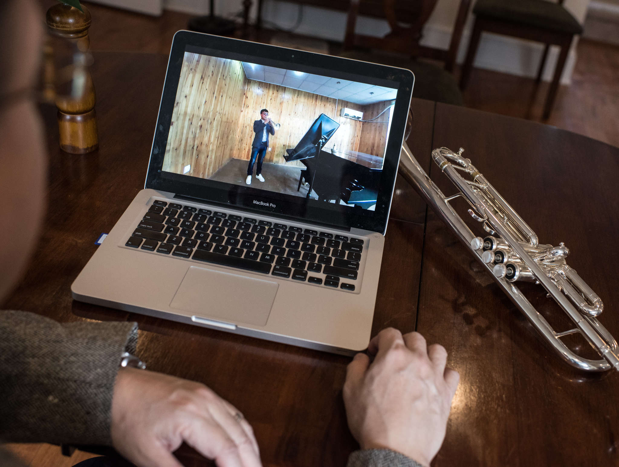 David Bilger , principal trumpeter for the Philadelphia Orchestra, watches a video of AhmadBaset Azizi. ANDREW RENNEISEN