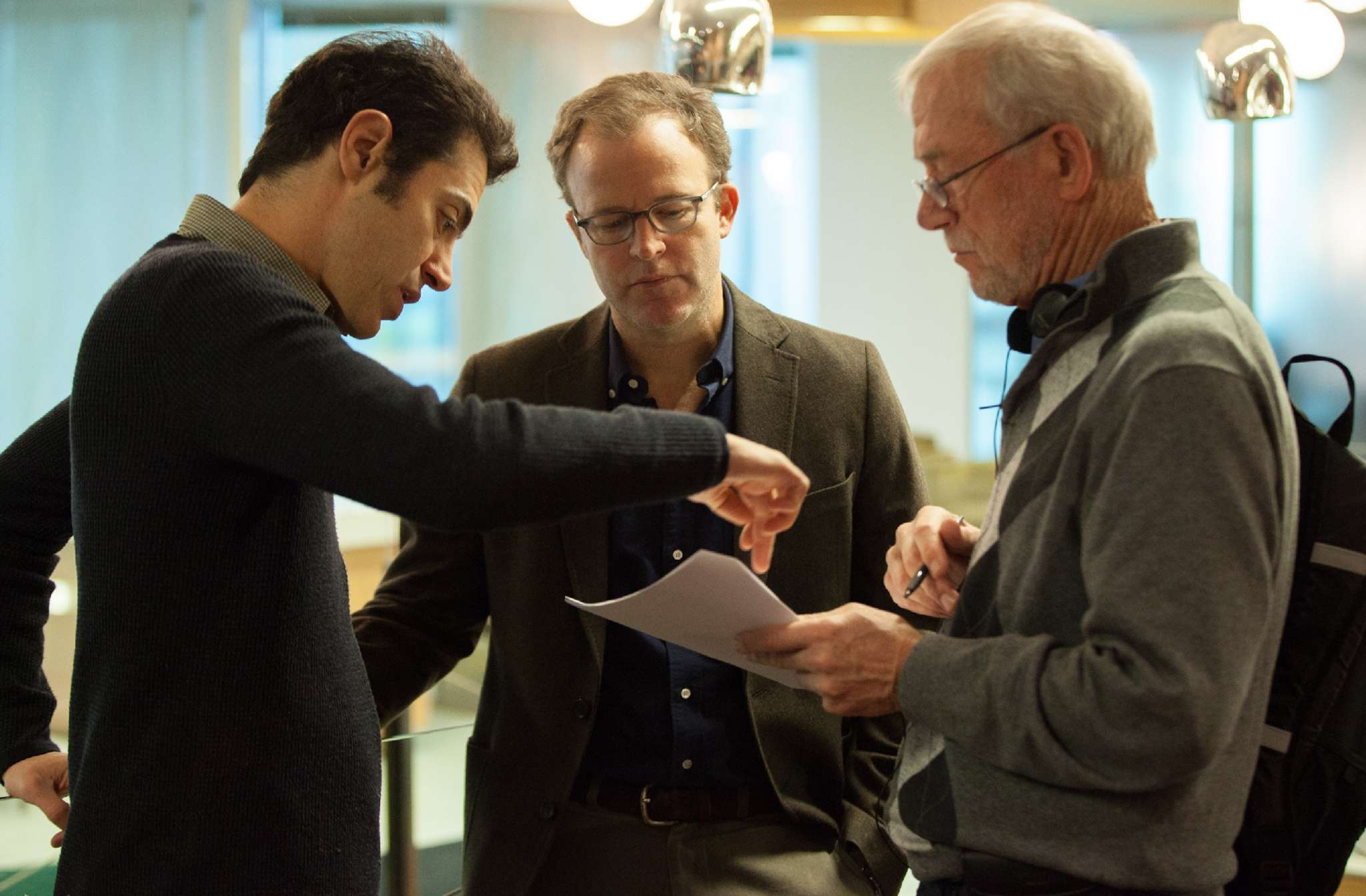 "On the set of ""Spotlight,"" about the Boston Globe investigation of pedophile priests, (from left) writer Josh Singer, co-writer/director Tom McCarthy, and Globe editor Walter Robinson confer."