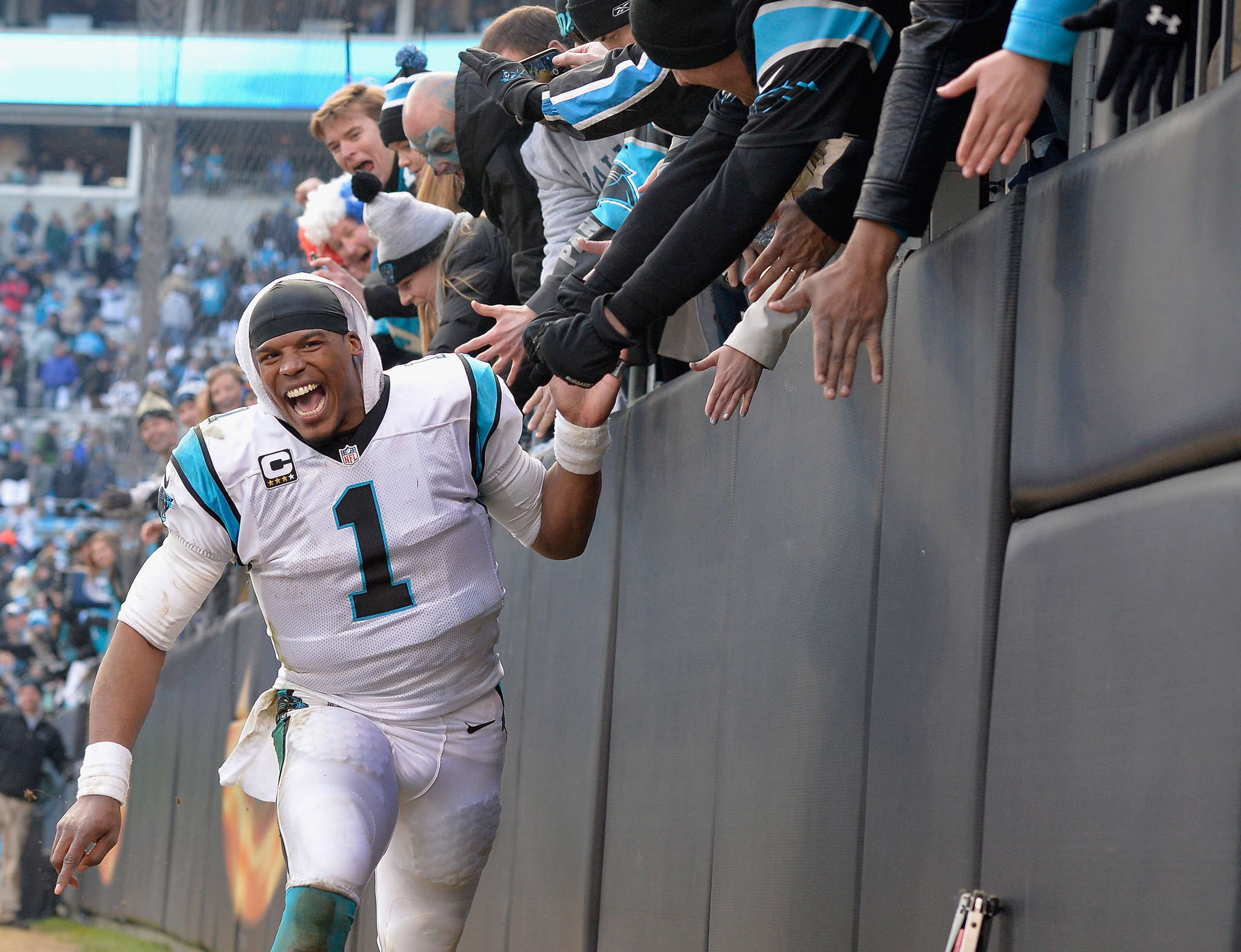 Cam Newtown celebrates with fans after leading Panthers to NFC Championship Game. ASSOCIATED PRESS