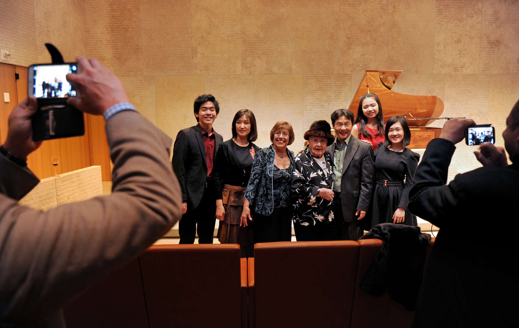 Piano instructor Eleanor Sokoloff (center) with some of the eight pianists, all former students, after their recital in her honor.