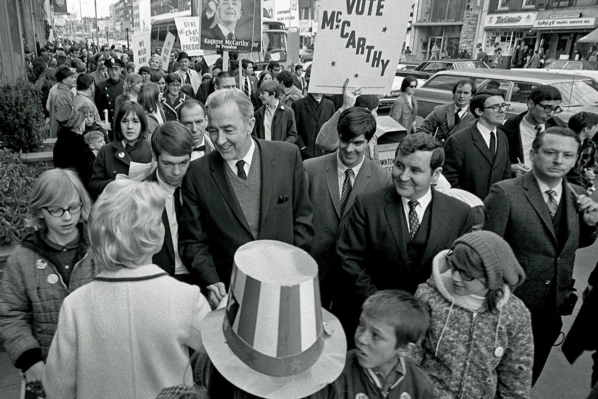 Sen. Eugene McCarthy campaigns on Main Street in Manchester, N.H., on March 9, 1968, three days before the year´s first primary in New Hampshire. Scores of college students, clean-shaven and conservatively clad at McCarthy´s insistence, were the force behind his campaign in New Hampshire.