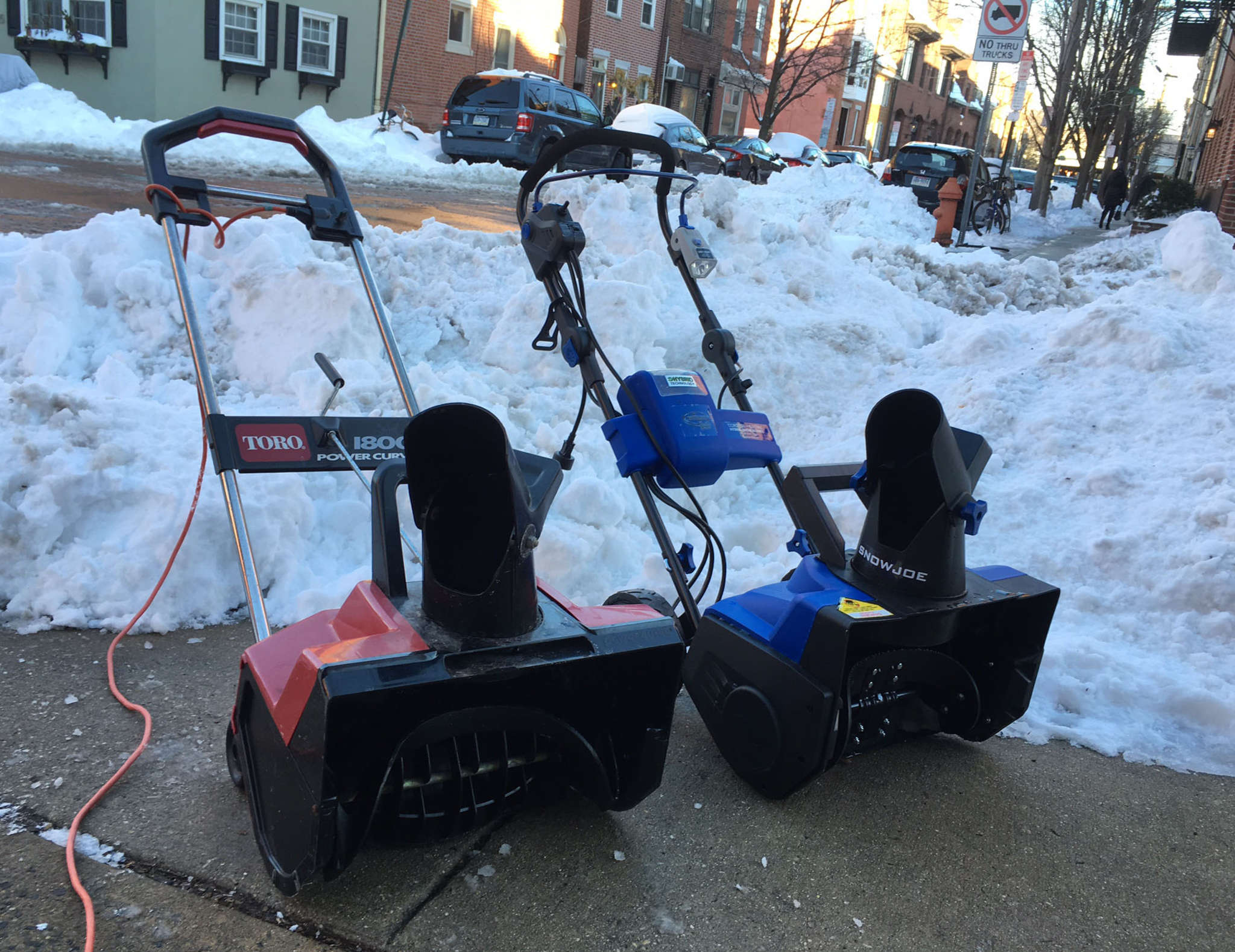 Hybrid Snow Joe (right) and plug-in Toro electric snow blowers have different benefits for cleanup.