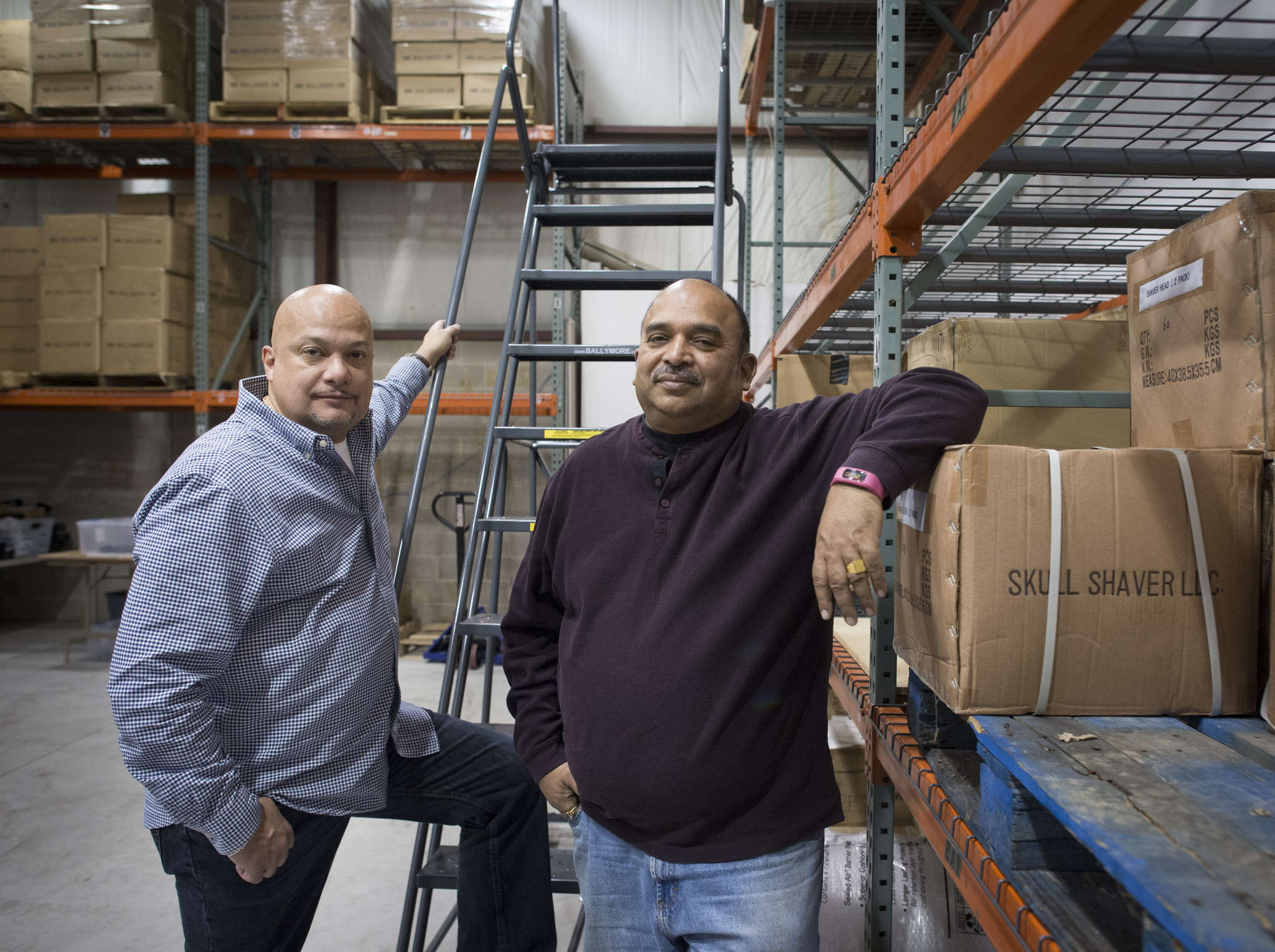 John Lyles (left) and Neel Kulshreshtha at their new warehouse in Moorestown. Lyles came up with the idea for the Skull Shaver company after he began shaving his own head.