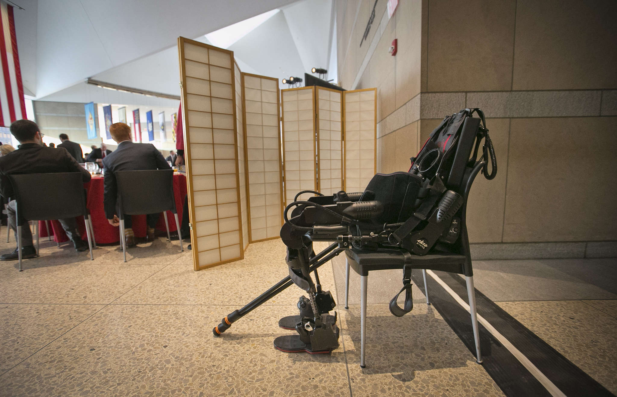 An exoskeleton suit sits in a chair waiting for Sgt. Dan Rose, who was paralyzed while serving in Afghanistan, to demonstrate its use.