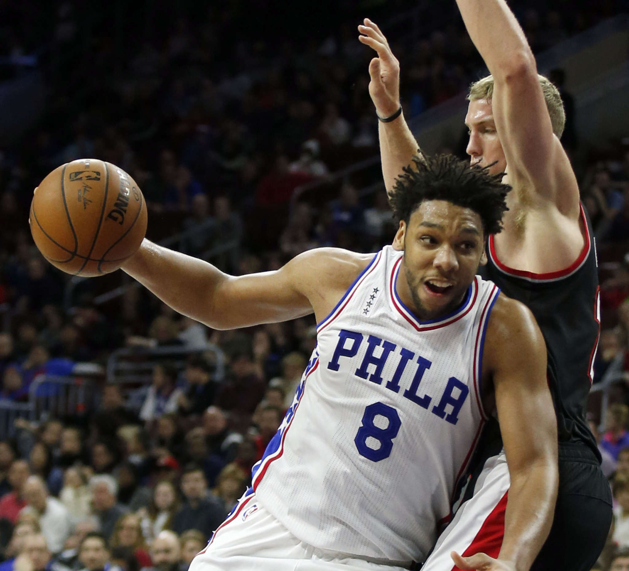 Jahlil Okafor driving against the Blazers´ Mason Plumlee. Okafor is an offensive threat down low but shoots just 39 percent when he´s more than three feet from the hoop. He has become a defensive liability for the Sixers. YONG KIM /Staff Photographer