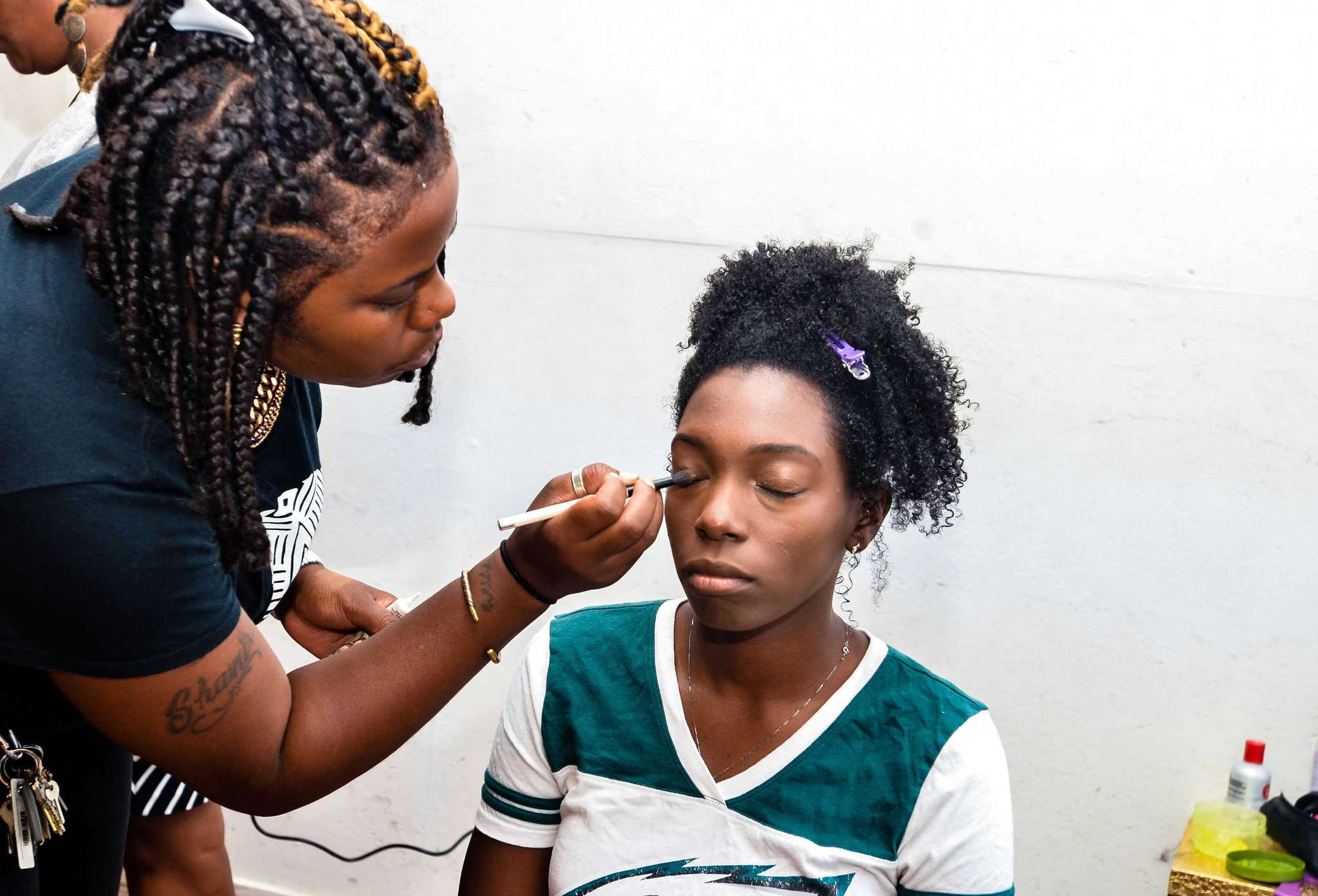 TresseNoire stylist Ve Dorsey applies makeup to client Damike Barr of Philadelphia. App TresseNoire offers African American clients wherever they are chemical-free styles like braids, locks, and Senegalese twists.