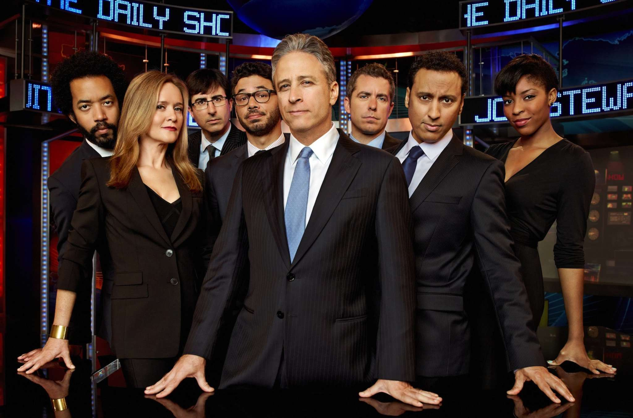 "Jon Stewart, former host of ""The Daily Show"" (center), with (from left) Wyatt Cenac, Samantha Bee, John Oliver, Al Madrigal, Jason Jones, Aasif Mandvi, and Jessica Williams."
