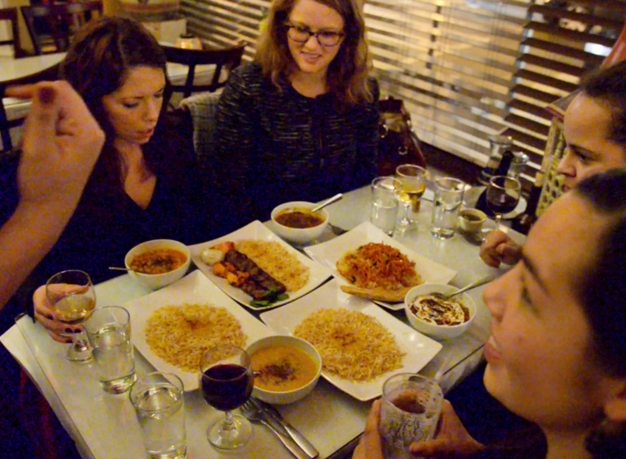 "Law school friends - (clockwise from left) Jacqueline Robbins, Rachael Eisenberg, Kenisha Marks, and Melissa Pang - who meet monthly at local restaurants and call themselves the ""Fat Four Dining Club,"" at Sansom Kabob House."