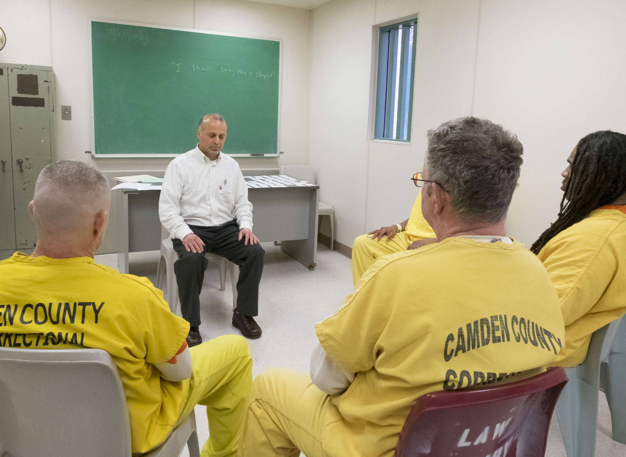 Stephen Michael Tumolo starts a session at the Camden County jail with moments of meditation.