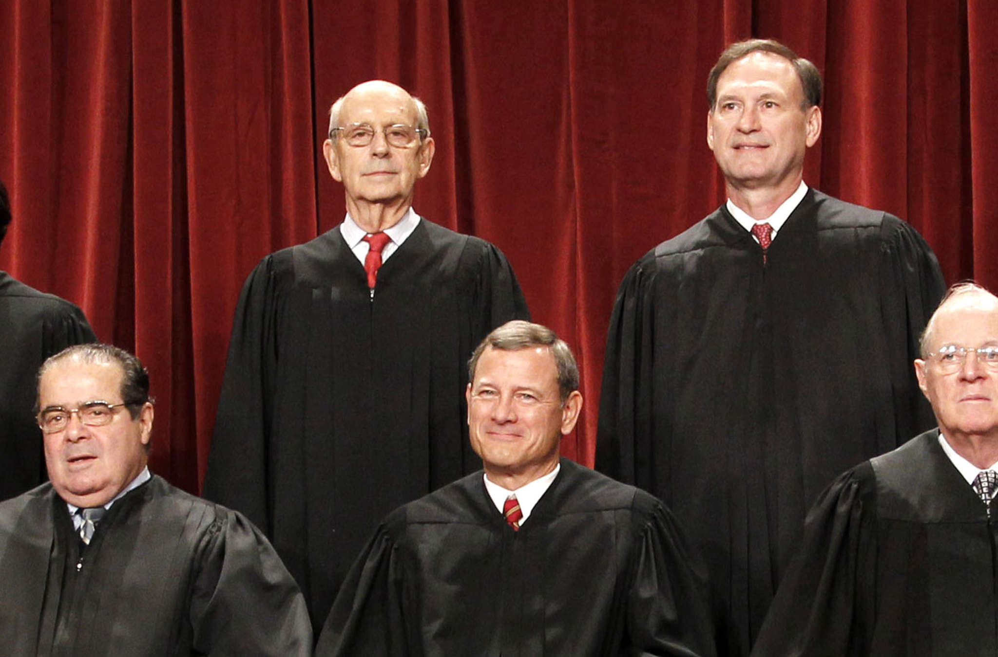 The official U.S. Supreme Court photo in 2010, with Justice Antonin Scalia at left.