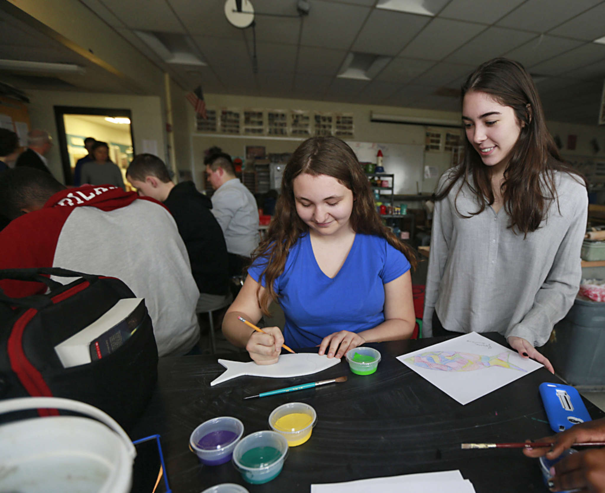 Artist Winter Willoughby- Spera watches Brianna Siciliano, a freshman at Gloucester City High, at work.