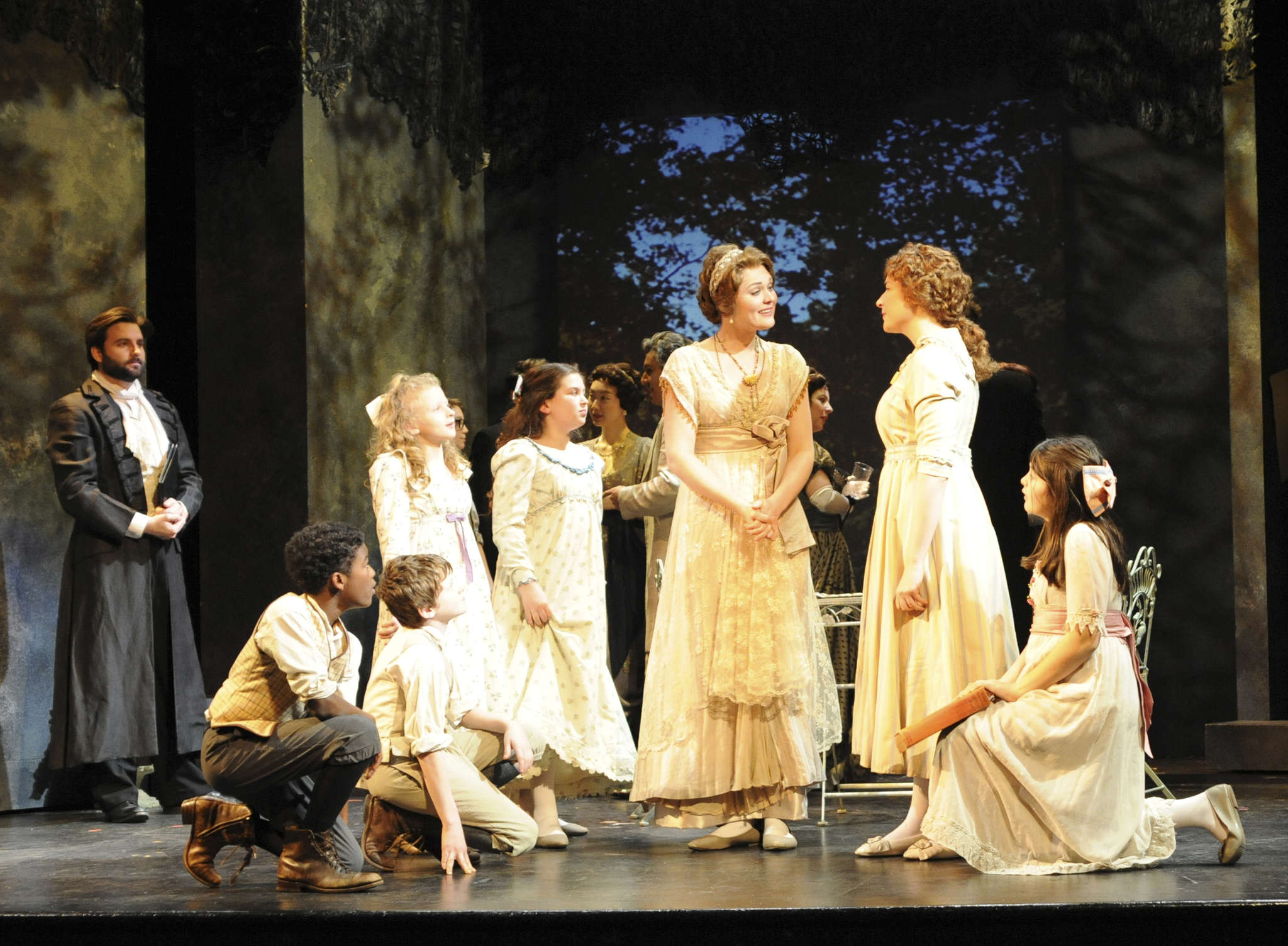 "The sorrows of love: (from left) Mackenzie Whitney, Alexandra Schenck, Alexandra Nowakowski with members of the Philadelphia Boys and Girls Choirs in AVA´s production of Massenet´s ""Werther."""