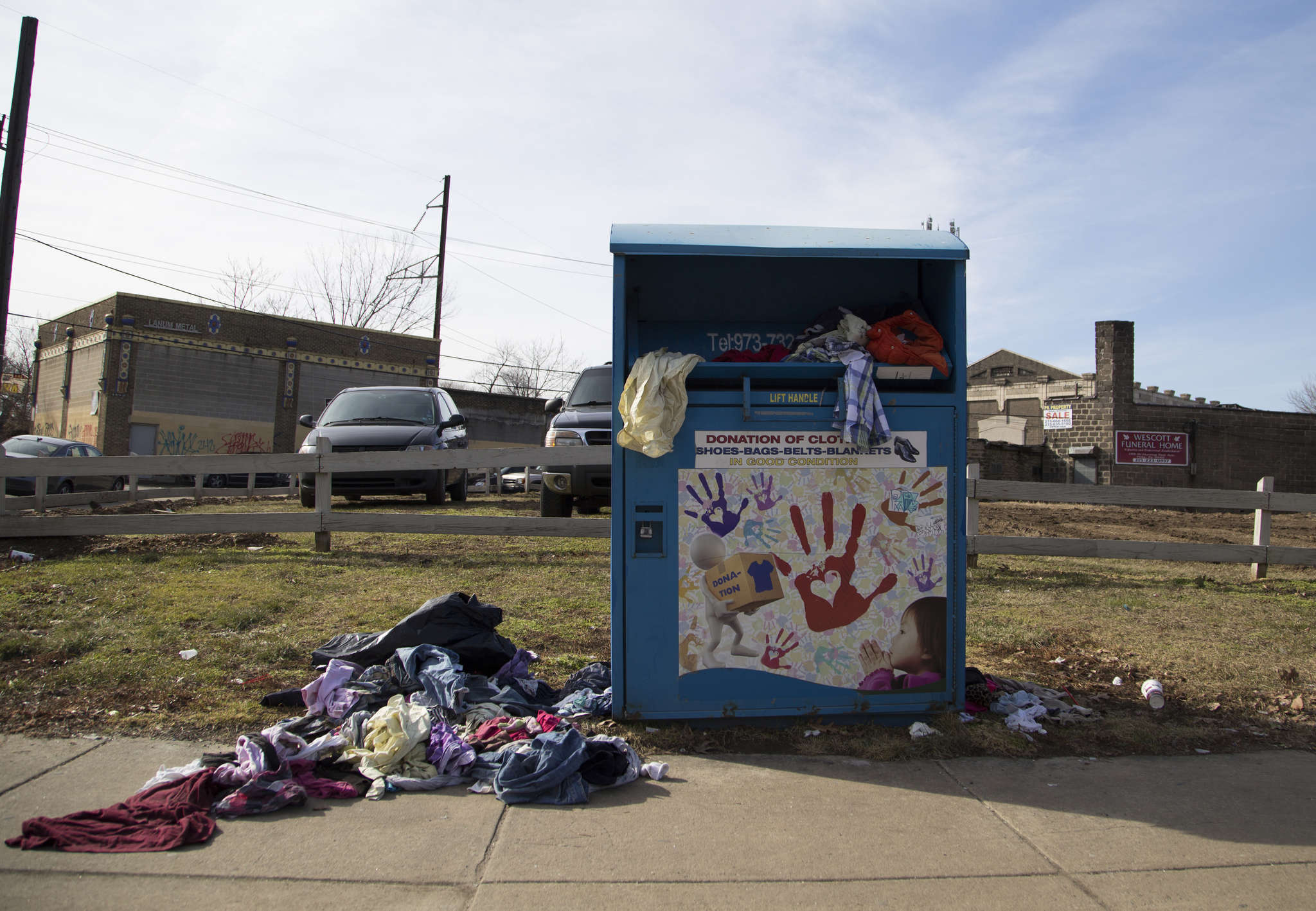 Just a guess , but there appear to be as many items on the ground as there are in this clothing-collection bin on the corner of Broad Street and Lycoming Avenue. JENNIFER KERRIGAN / Staff Photographer