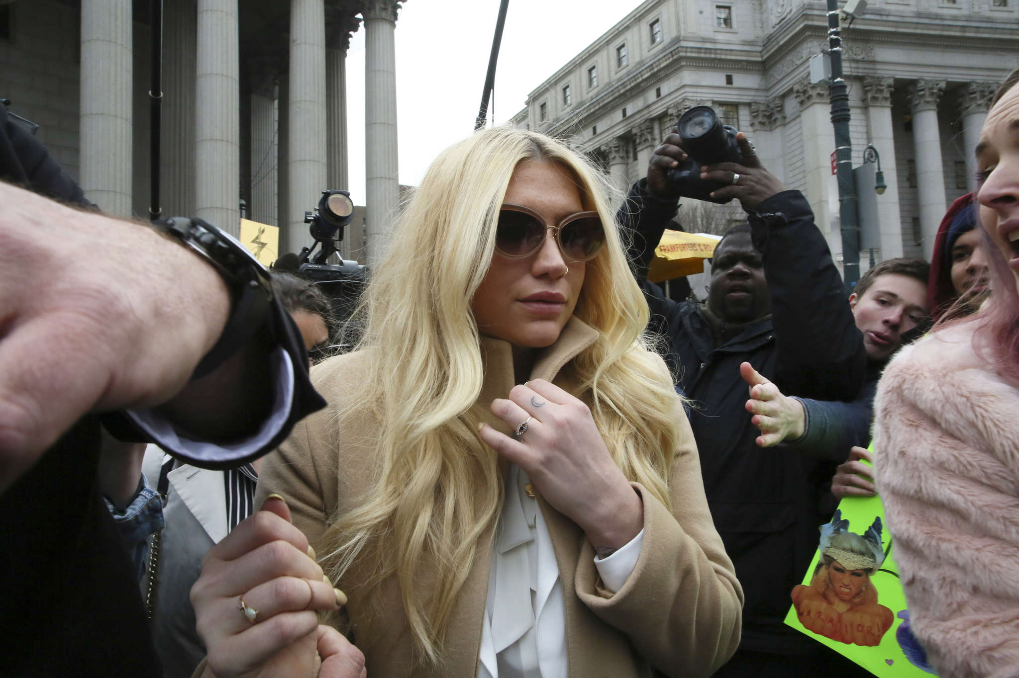 Pop star Kesha leaves court in New York on Friday. Kesha is fighting to wrest her career away from a hitmaker she says drugged, sexually abused, and psychologically tormented her - and still has exclusive rights to make records with her. Producer Dr. Luke says the singer is slinging falsehoods and ruining his reputation to try to weasel out of her recording contract and strike a new deal.