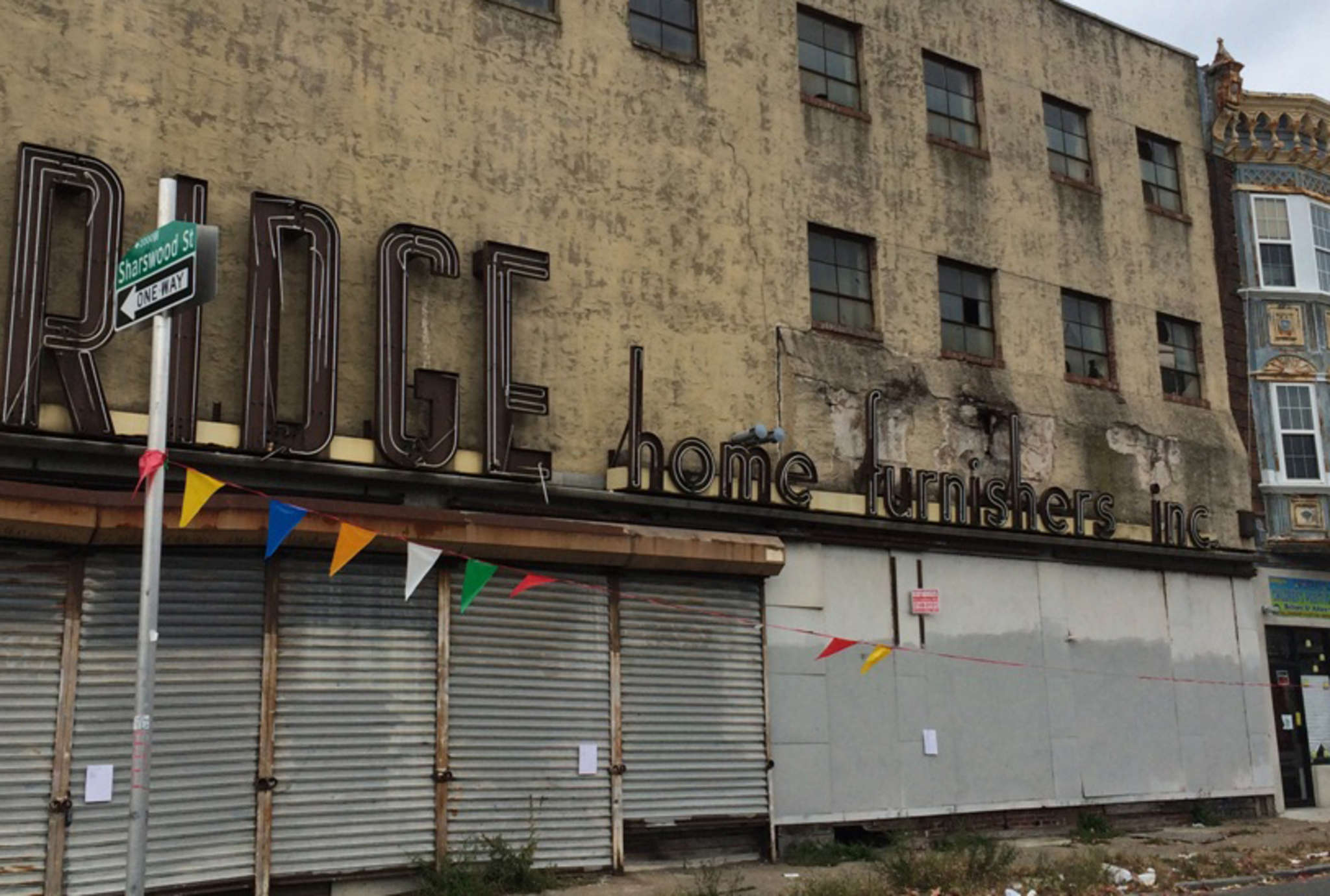 An ex-furniture store , shuttered on Cecil B. Moore Avenue. INGA SAFFRON