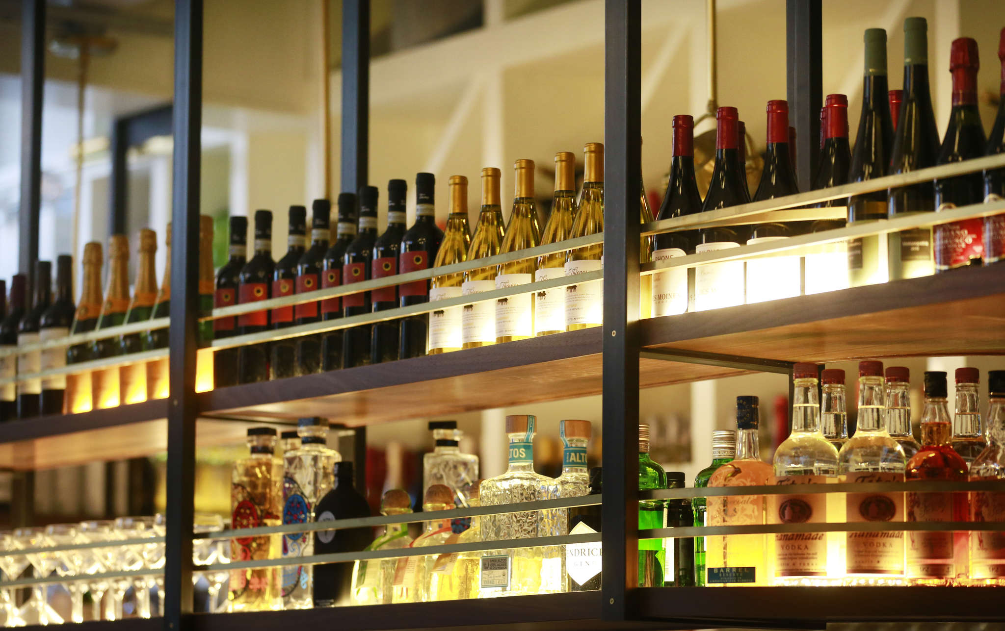 Fine wines behind glass at Tredici Enoteca. Among the restaurant´s strengths are its well-informed servers, who are able guides to the extensive wine list and menu.