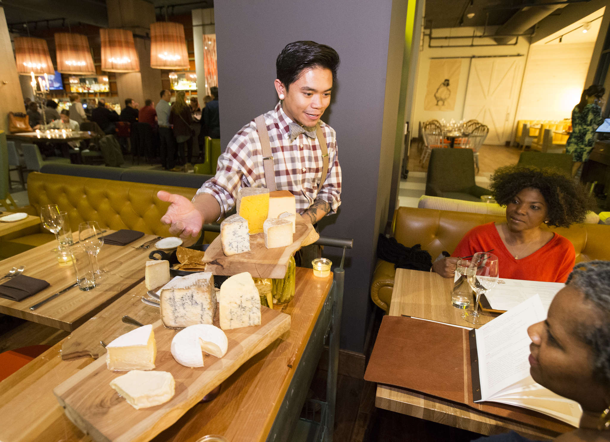 Jeffrey Rubio pushes a cheese cart at Urban Farmer.