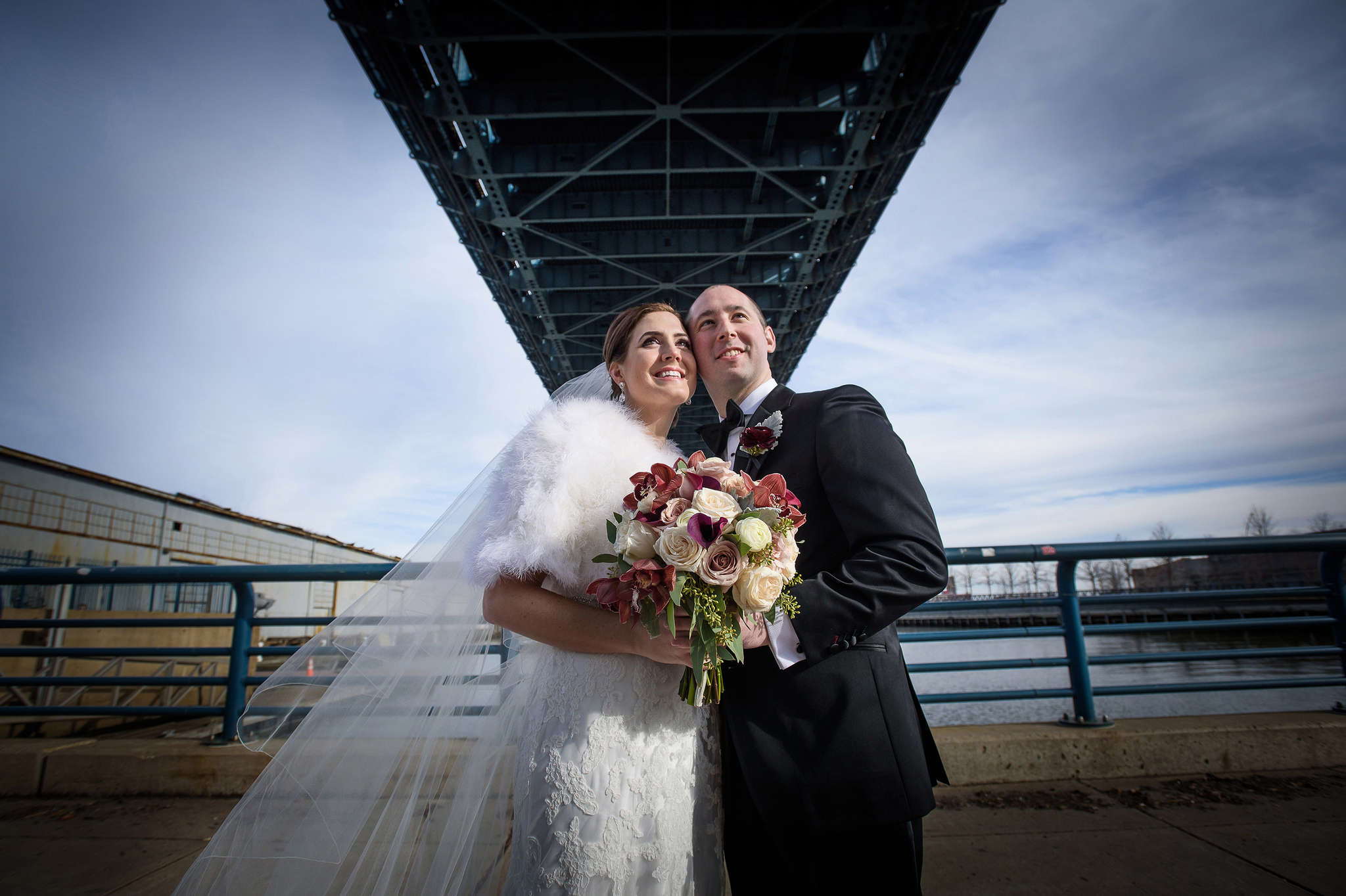 Bride Lauren Moore and groom Charles Concodora underneath the Ben Franklin Bridge on their wedding day, Feb. 6, 2016.