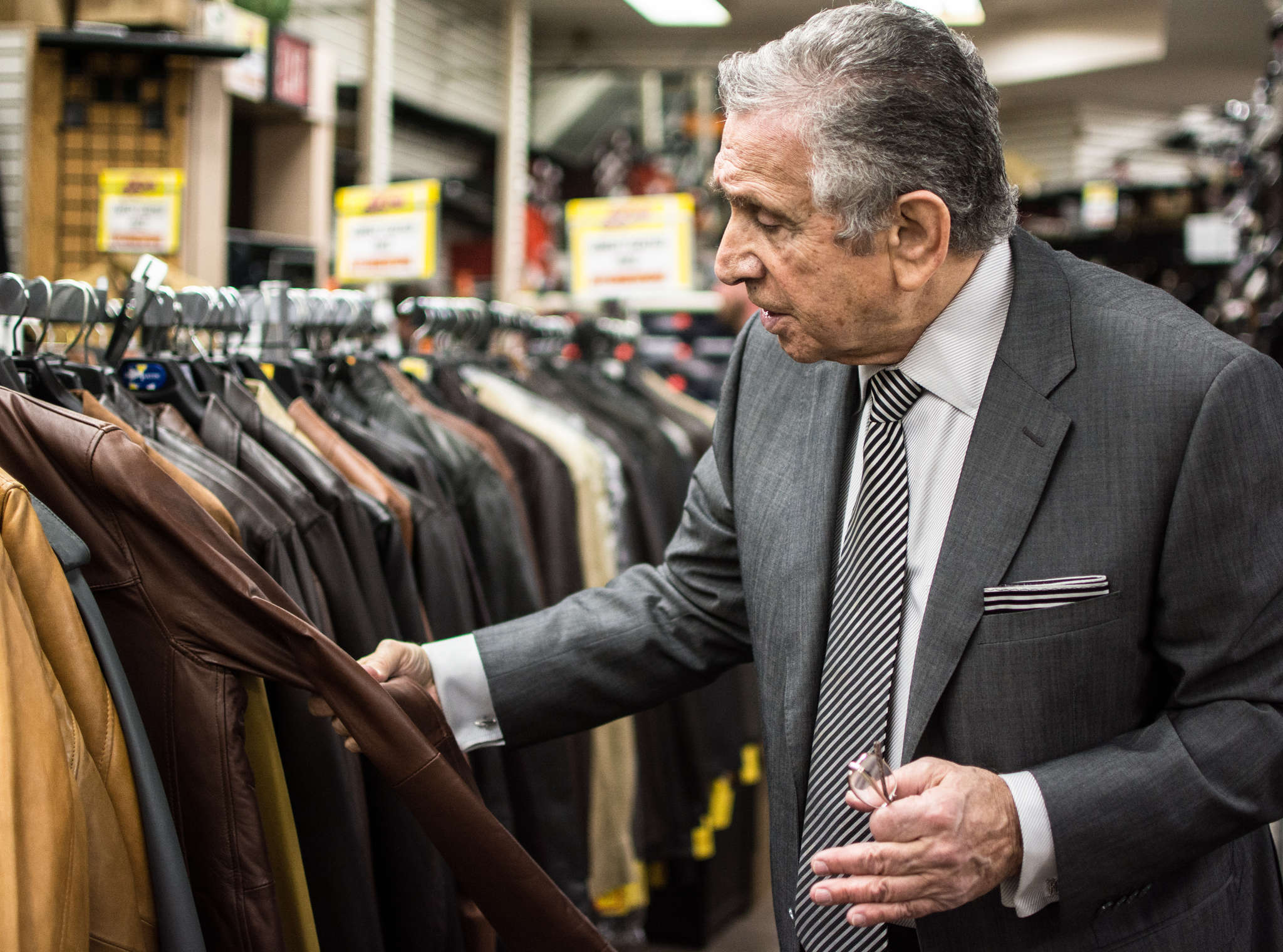 Abe Mandel shows off a leather jacket in A Man´s Image, on East Passyunk Avenue in Philadelphia.
