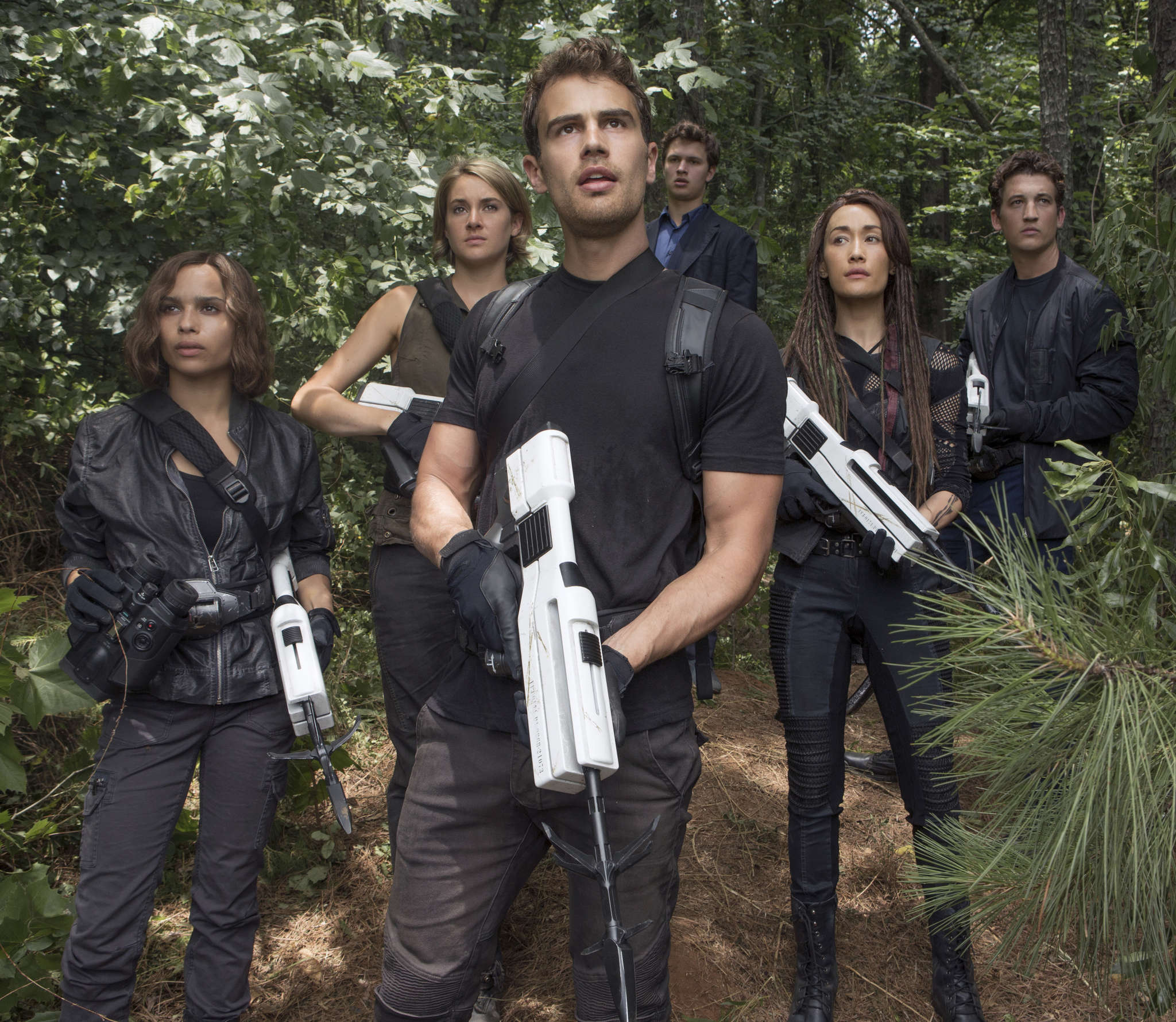 "In ""Allegiant — Part 1,"" the third of four ""Divergent"" films based on the Veronica Roth YA books (from left): Zoe Kravitz, Shailene Woodley, Theo James, Ansel Elgort, Maggie Q, and Miles Teller. Missing from the movie is baddie Kate Winslet, replaced by Naomi Watts. MURRAY CLOSE / Lionsgate"
