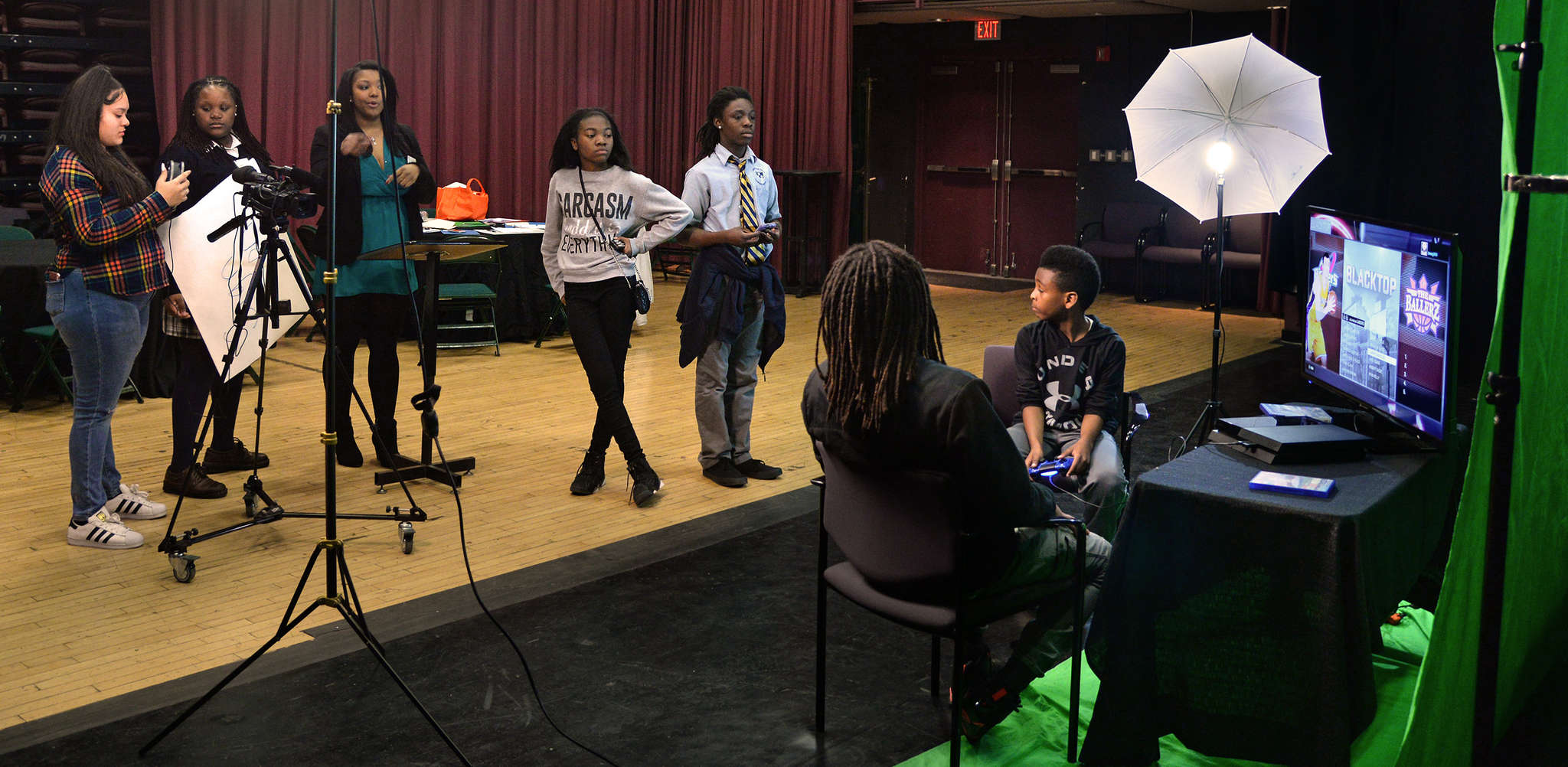 Recording a news segment at the school (from left): Naiyarie Sandoval, 14; Elisabeth Martin, 15; teacher Christina Collins; Jabriah Anderson, 13; and Niger Ali, 14, joined by Bryce Pellot, 10 (right).