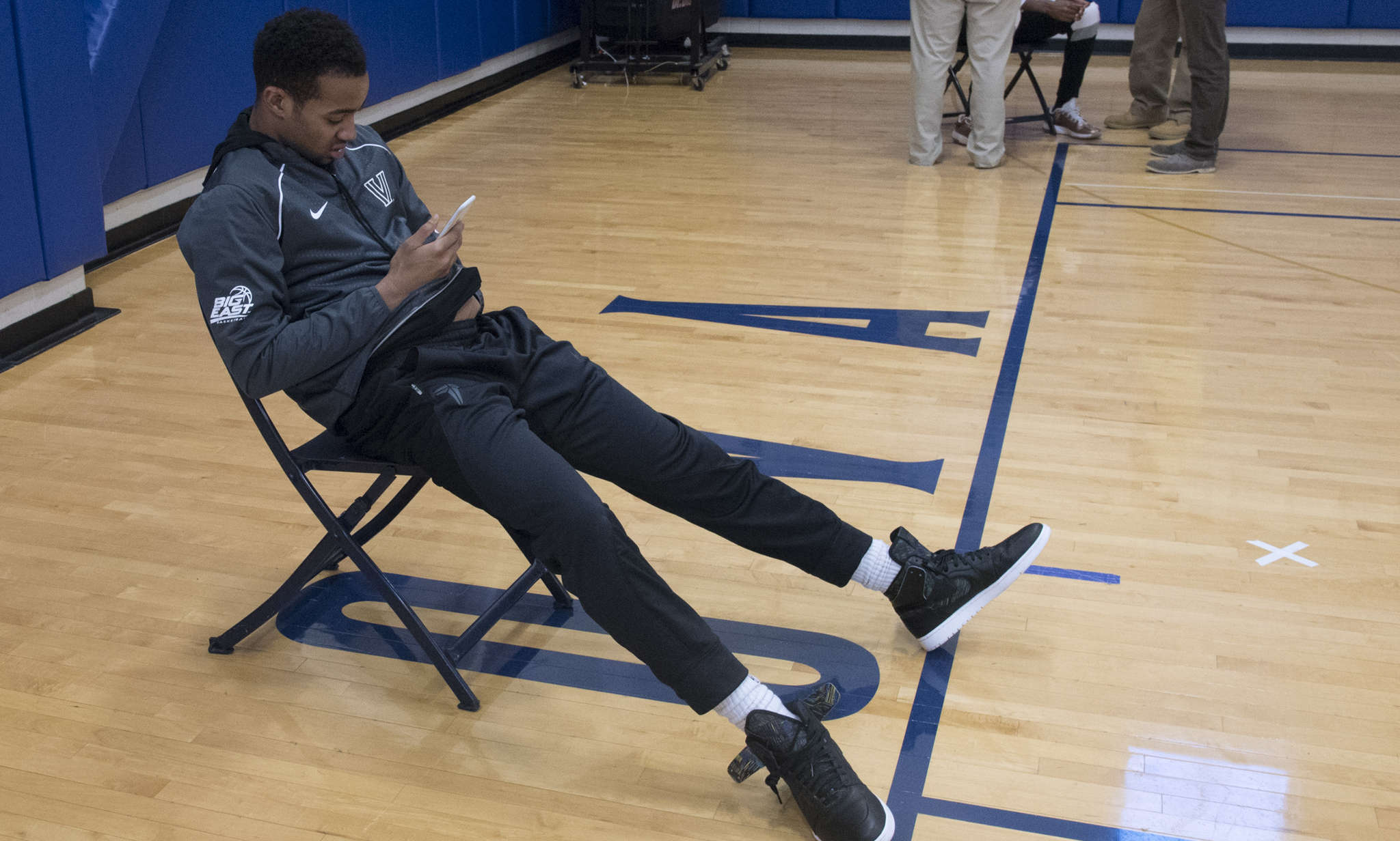 Sophmore guard Phil Booth looks at his smartphone during a break at Villanova´s media availability. CLEM MURRAY / Staff Photographer