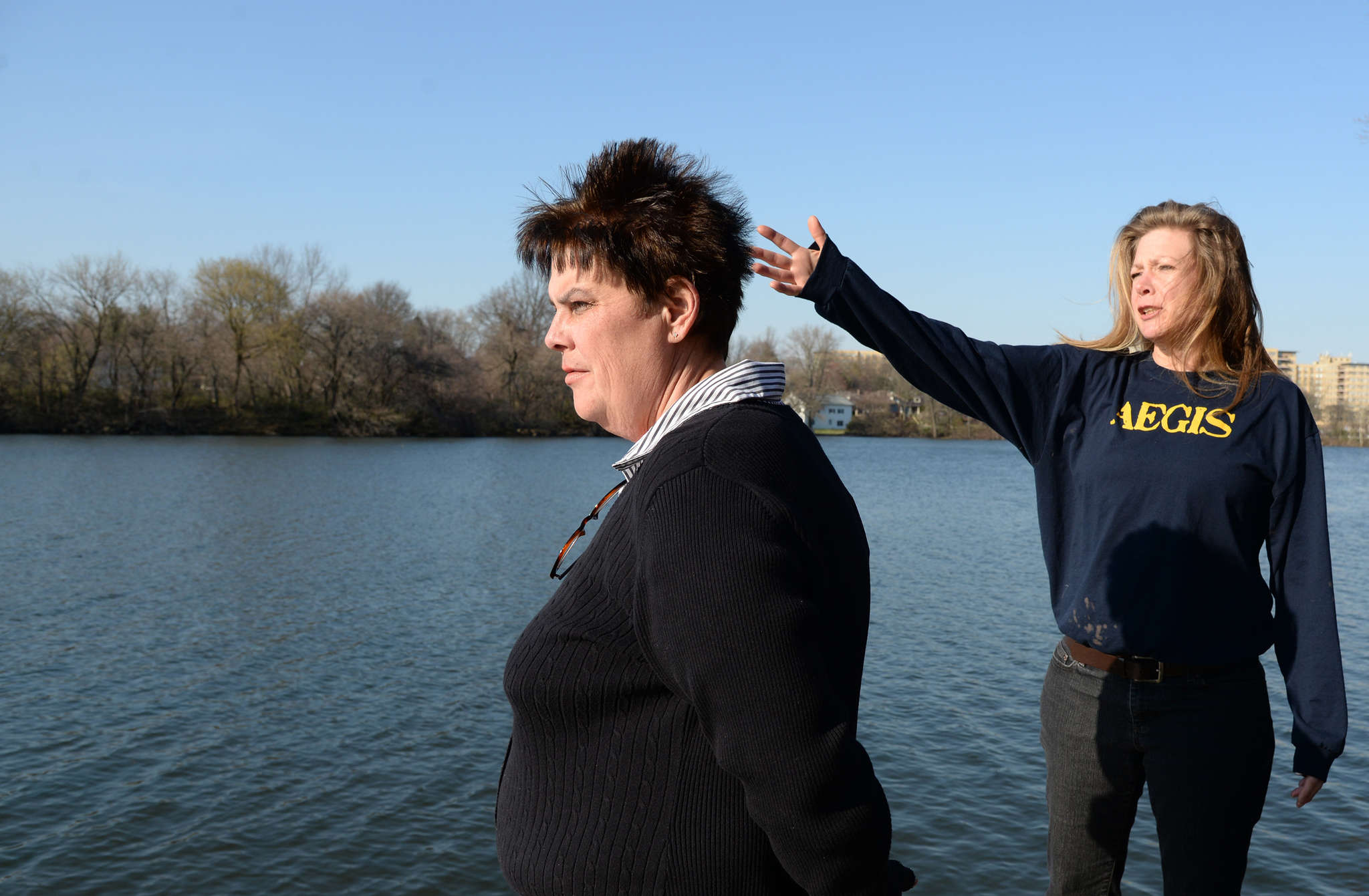 "Melissa Martin (left) and Sandy Harris are part of an effort to clean up Newton Lake. ""Things are changing, and not for the better,"" Harris says. ""I have a paddle boat, and I can´t take it out because of the algae."""