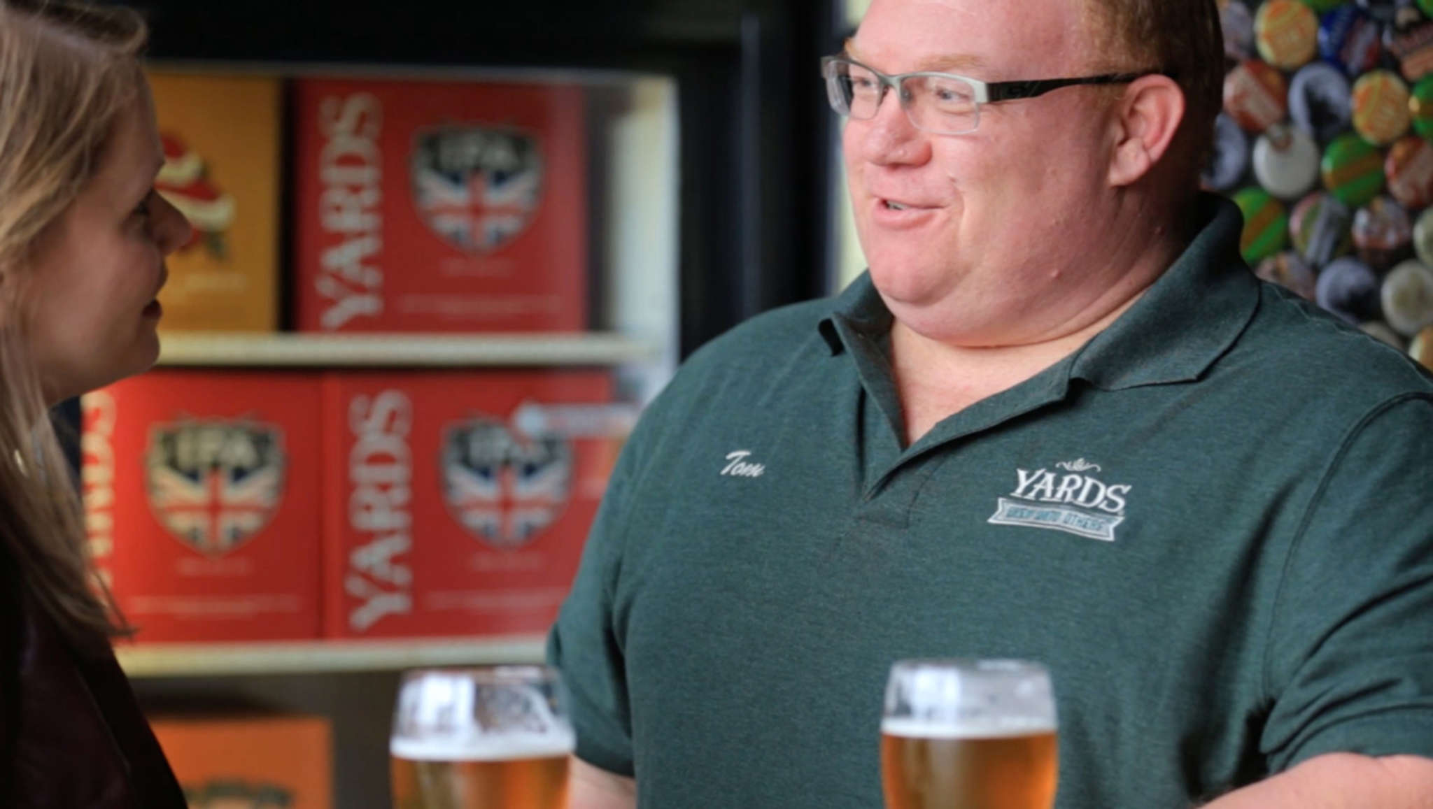Sarah DeLaurentis of ActionAIDS with Yards Brewing Co. president Tom Kehoe in a Yards video.