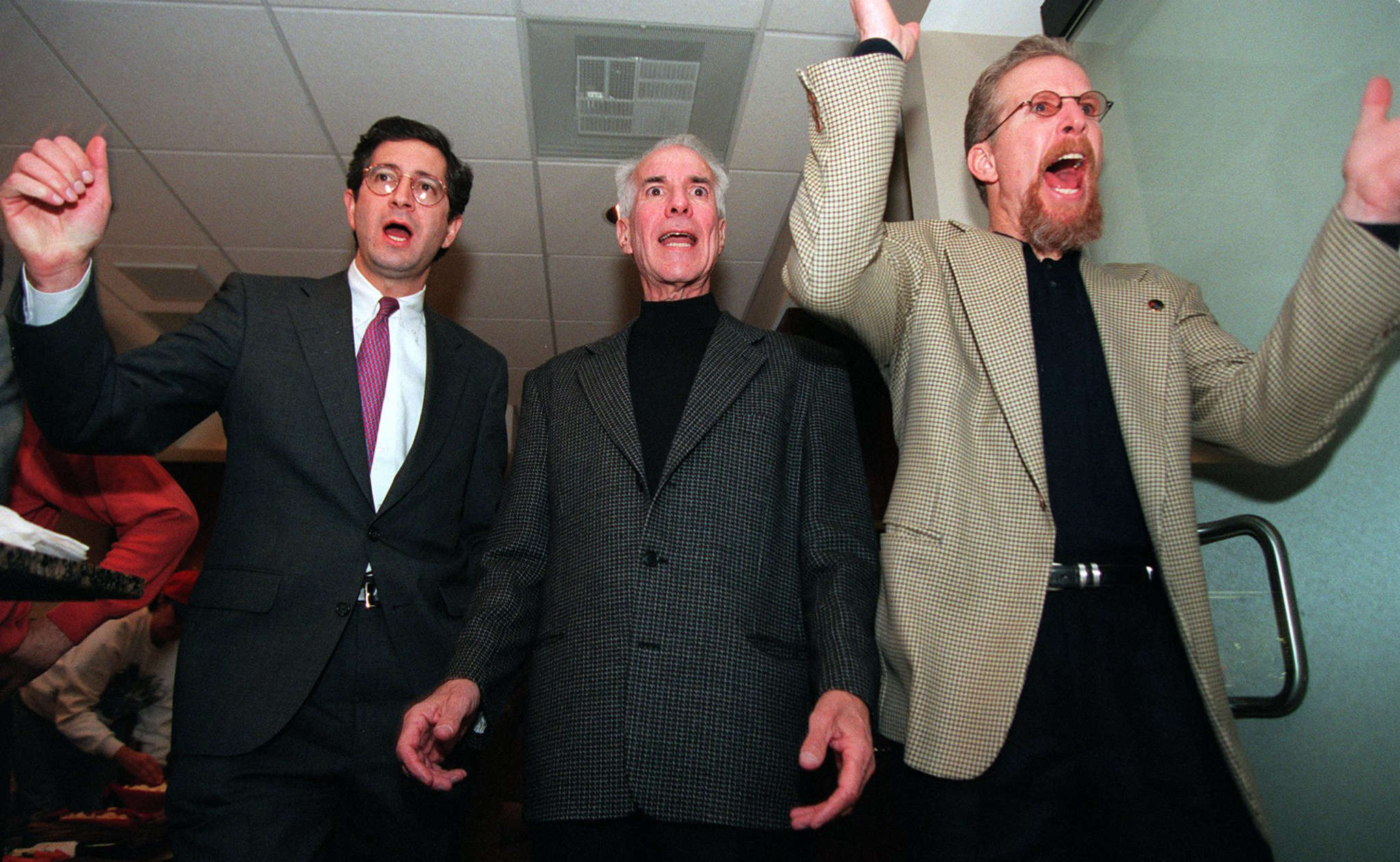 Cheering the Sixers in 1996 were (from left) Brian Roberts, Ed Snider, and Pat Croce. Roberts says he trusted Snider as a mentor.