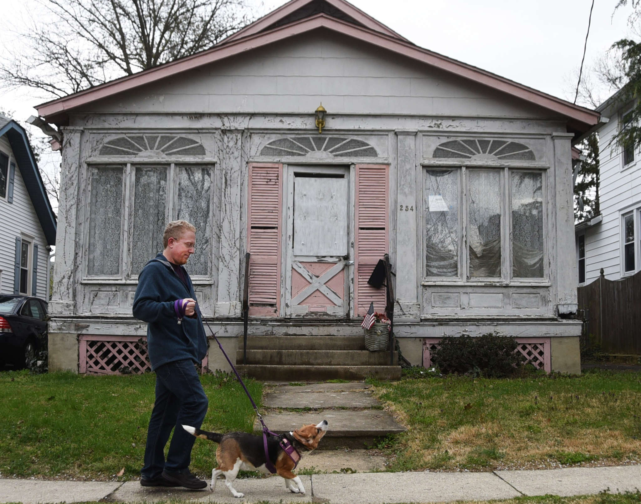 Ric Schoeffling strolls past a house on Harvard Avenue , one of Collingswood´s 40 abandoned homes. Collingswood, Gloucester City, Pennsauken, and Merchantville are part of a program to rehab and sell abandoned houses. CURT HUDSON