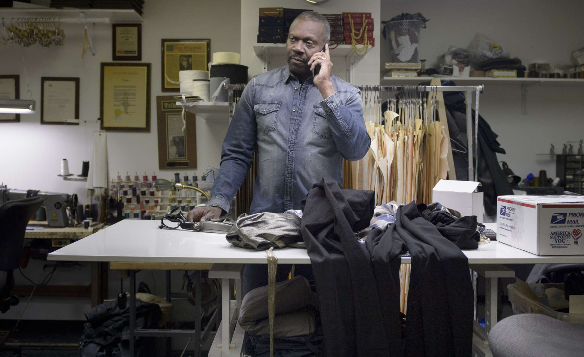 Ron Wilch works his magic at the Wardrobe Clinic in Center City, a one-man shop that specializes in alterations for clients who purchase clothing online.