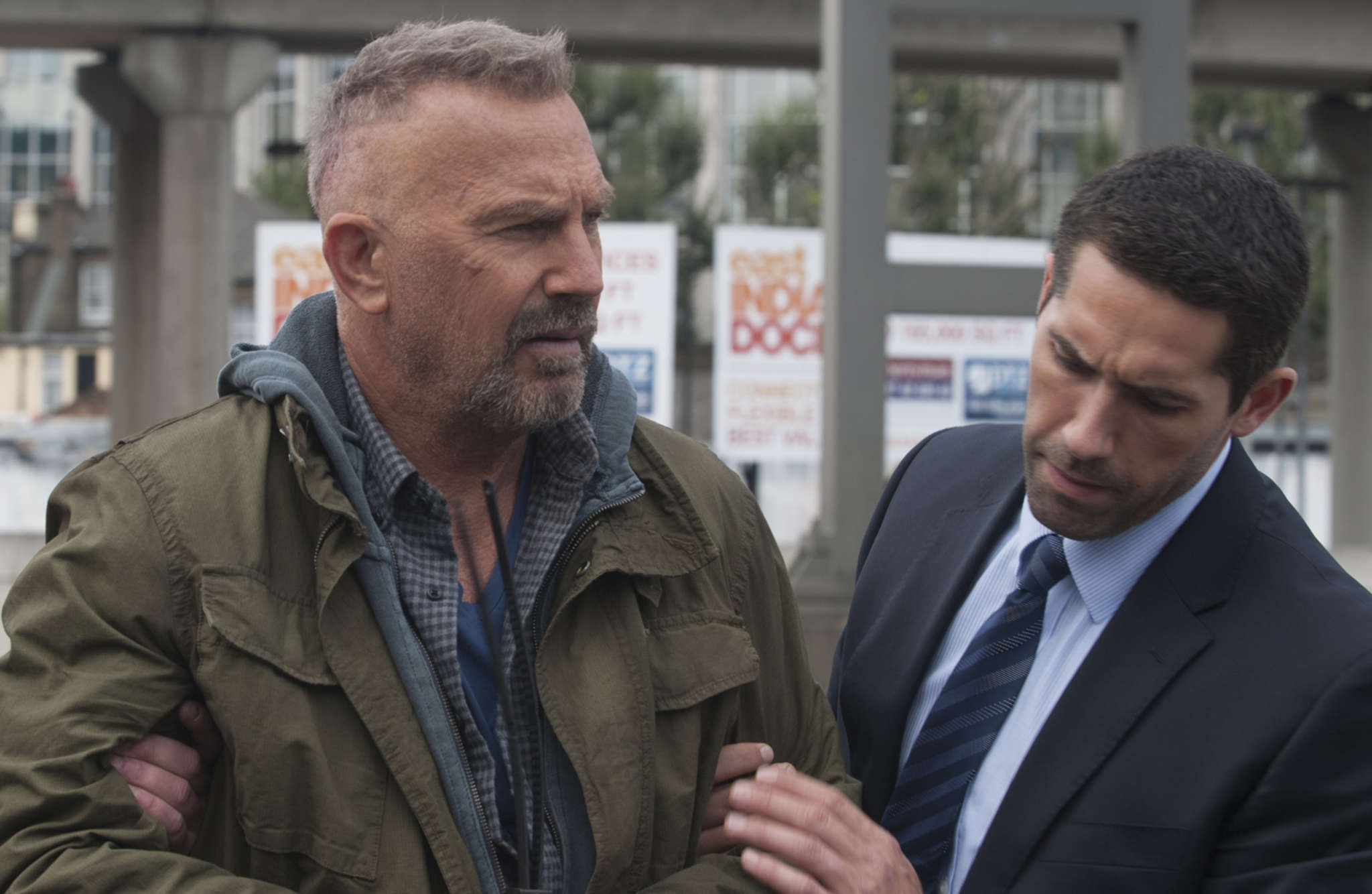 """Kevin Costner (left, with Scott Adkins) is a sociopath who undergoes a memory swap in the espionage thriller """"Criminal."""""""