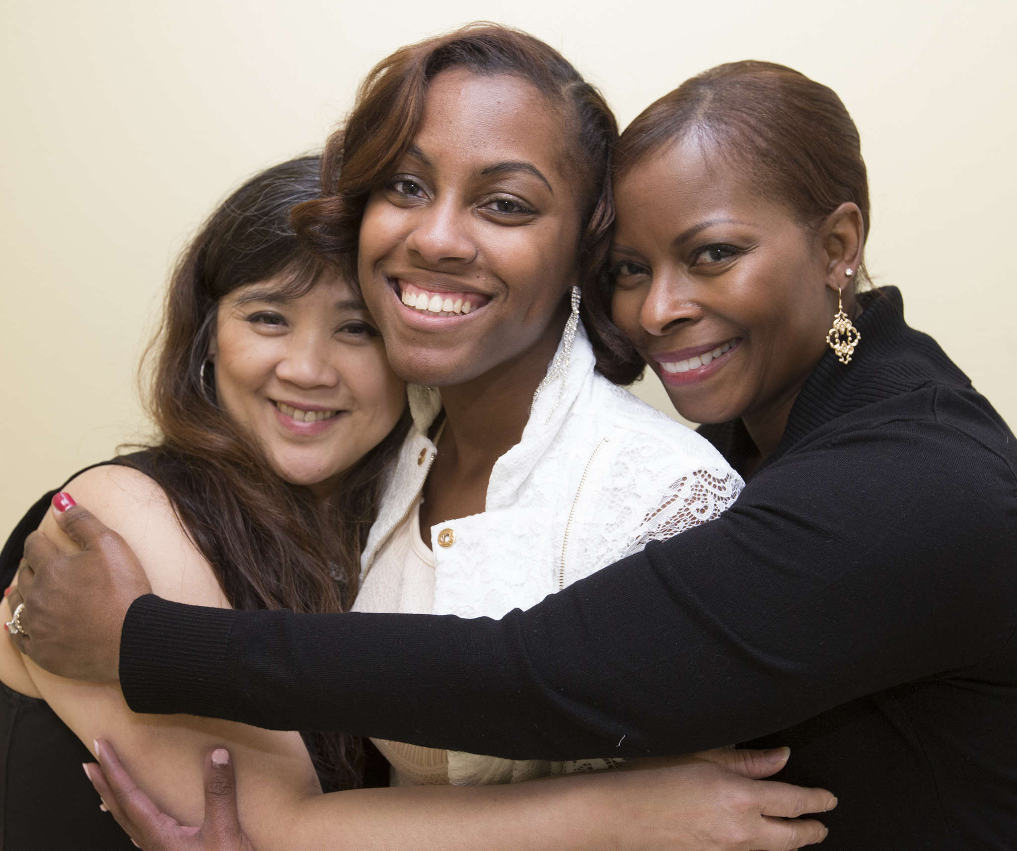 Angelica Owens (center) with Maria Trillana (left) and Sharon Hackney-Robinson, who cared for her. CHARLES FOX / Staff Photographer
