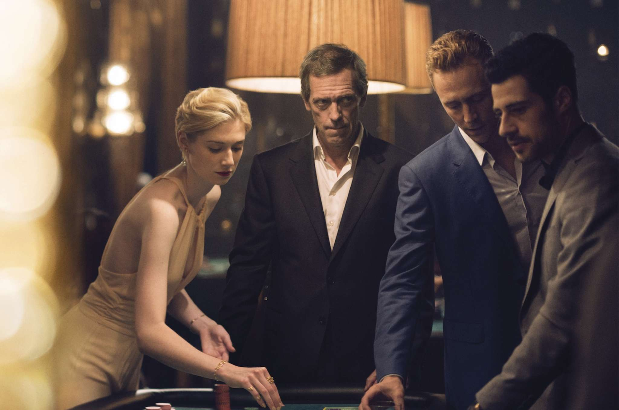 "AMC´s six-part John le Carré adaptation, ""The Night Manager,"" includes (from left) Elizabeth Debick as Jed Marshall, Hugh Laurie as charming villain Richard Onslow Roper, and Tom Hiddleston as British soldier-turned-hotelier Jonathan Pine."