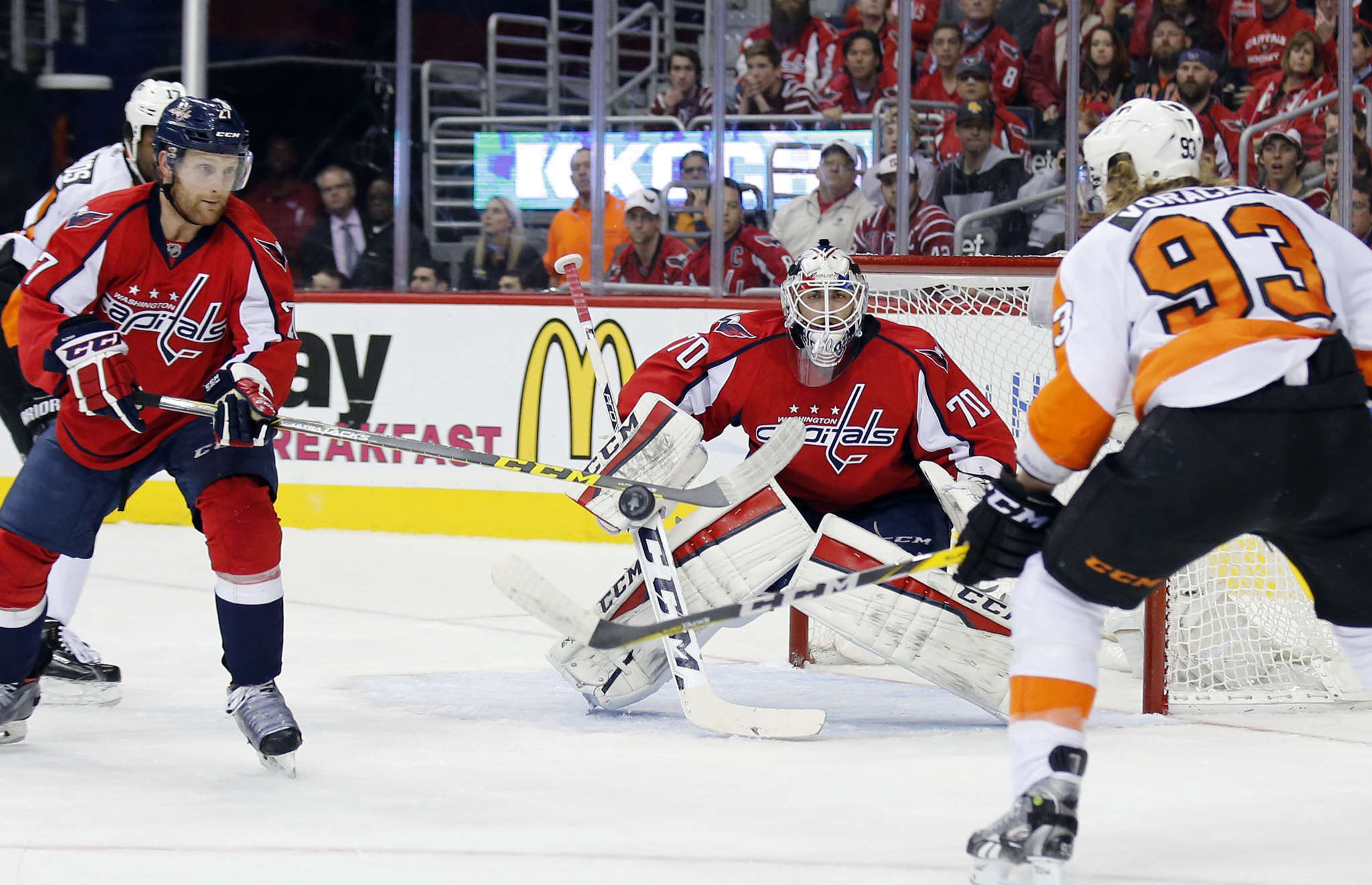 Jake Voracek´s shot is blocked by defenseman Karl Alzner before it reaches goaltender Braden Holtby. YONG KIM / Staff Photographer