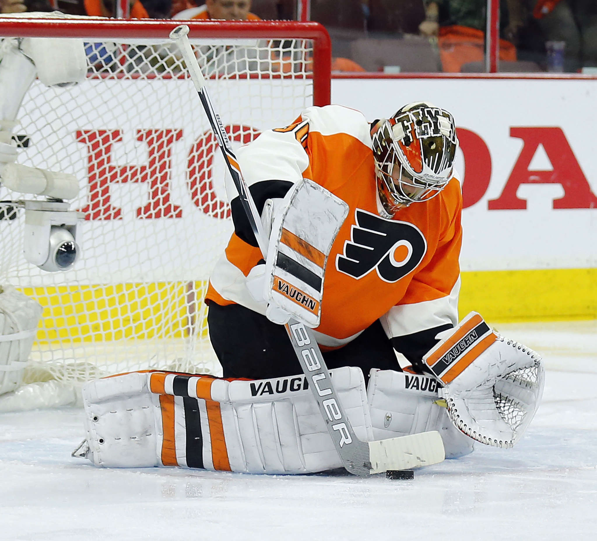 Flyers goalie Michal Neuvirth stops the puck with his stick in the second period. YONG KIM/Staff Photographer