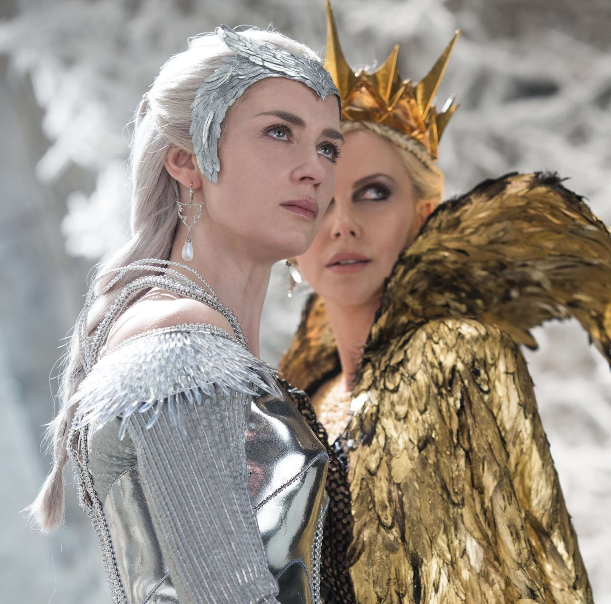 """Emily Blunt is Freya, Her Frosty Majesty, and Charlize Theron (right) is Ravenna, her evil sister, in """"The Huntsman: Winter´s War."""""""