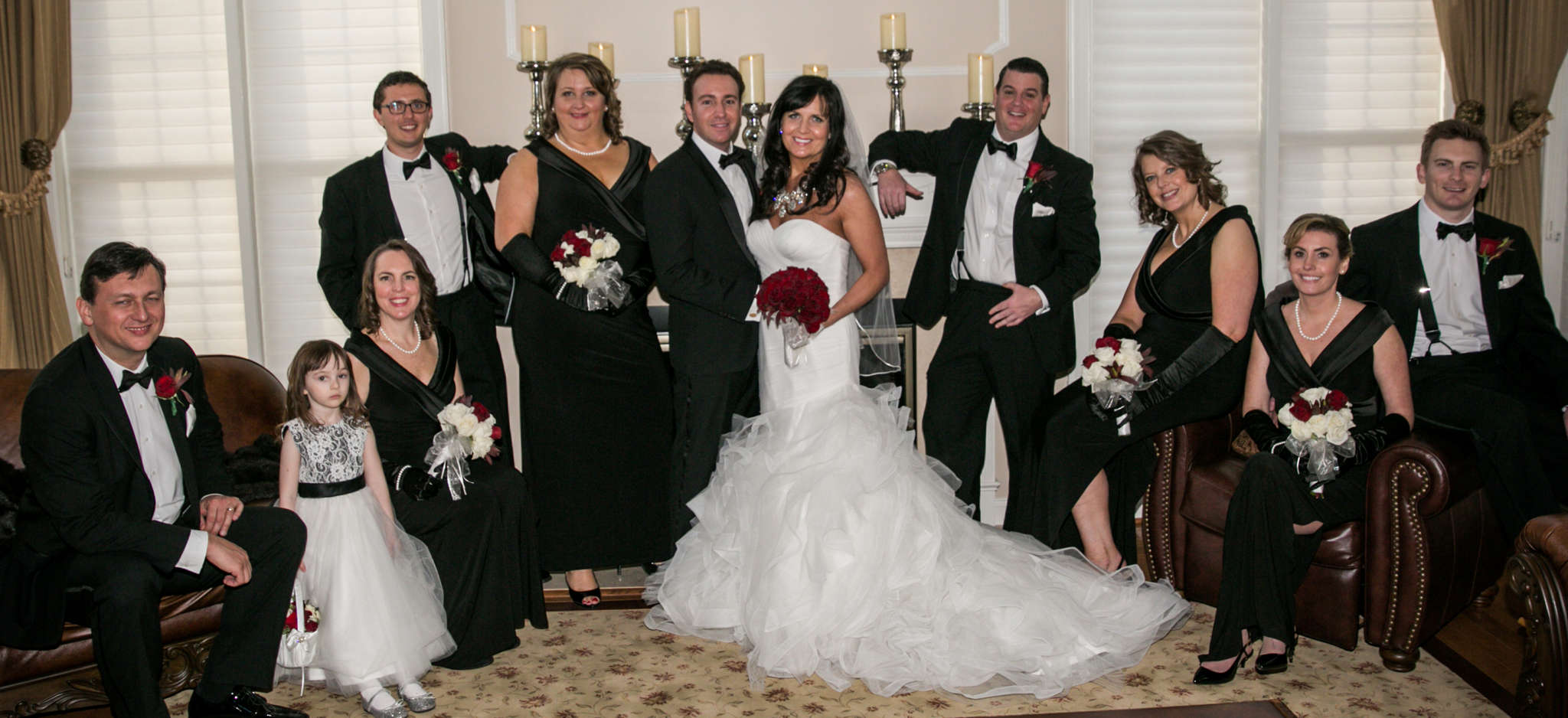 The bridal party with the groom and bride. From left are Joseph Willey, Grace Willey, Nicole Willey, Sean Mullin, Paula Galeano, John Iannozzi, Sue Weiss, Megan (Iannozzi) Grau, and Andrew Grau.