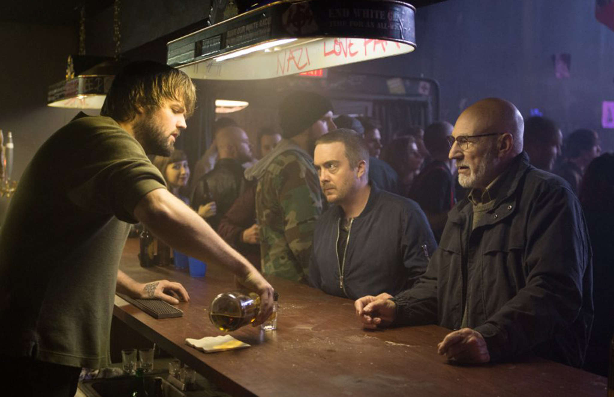 """Macon Blair (center) with Patrick Stewart in the punk rock thriller """"Green Room,"""" directed by Jeremy Saulnier. """"That was just serendipitous,"""" Saulnier says of getting Stewart to be in the film. """"It was really about him taking the leap in making a risky film happen."""""""