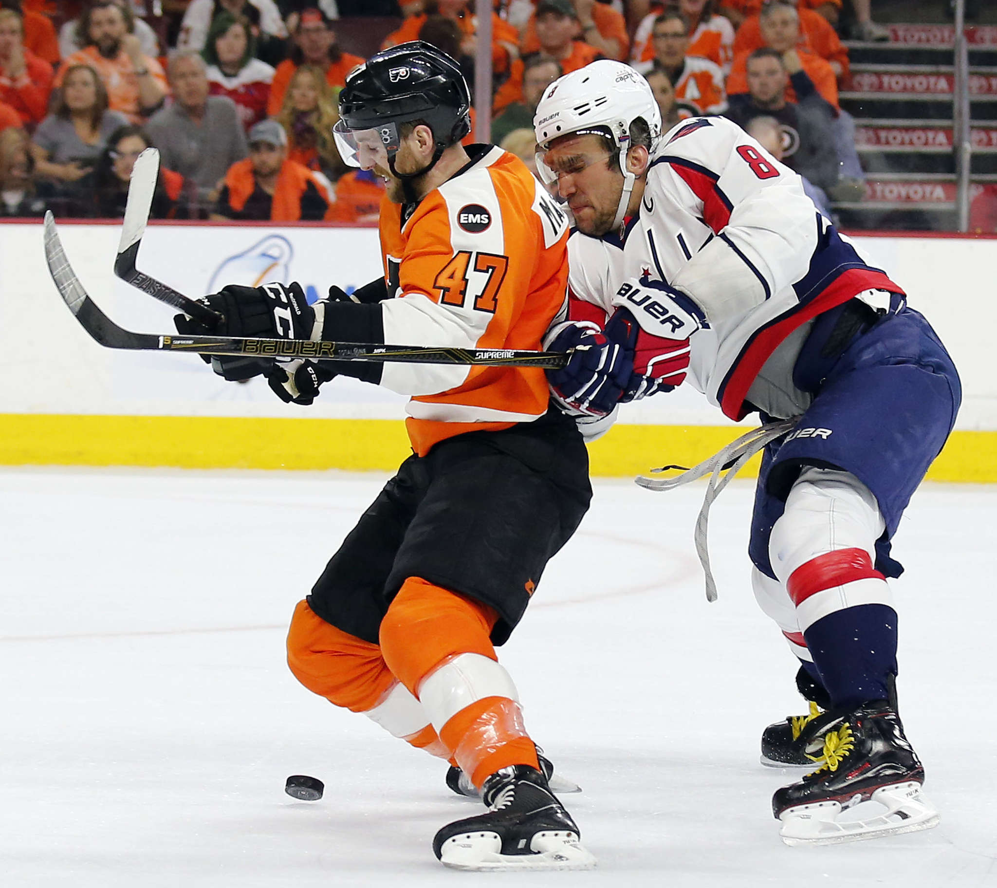 Caps´ Alex Ovechkin shoves Flyers´ Andrew MacDonald off the puck in Game 6. YONG KIM / Staff Photographer