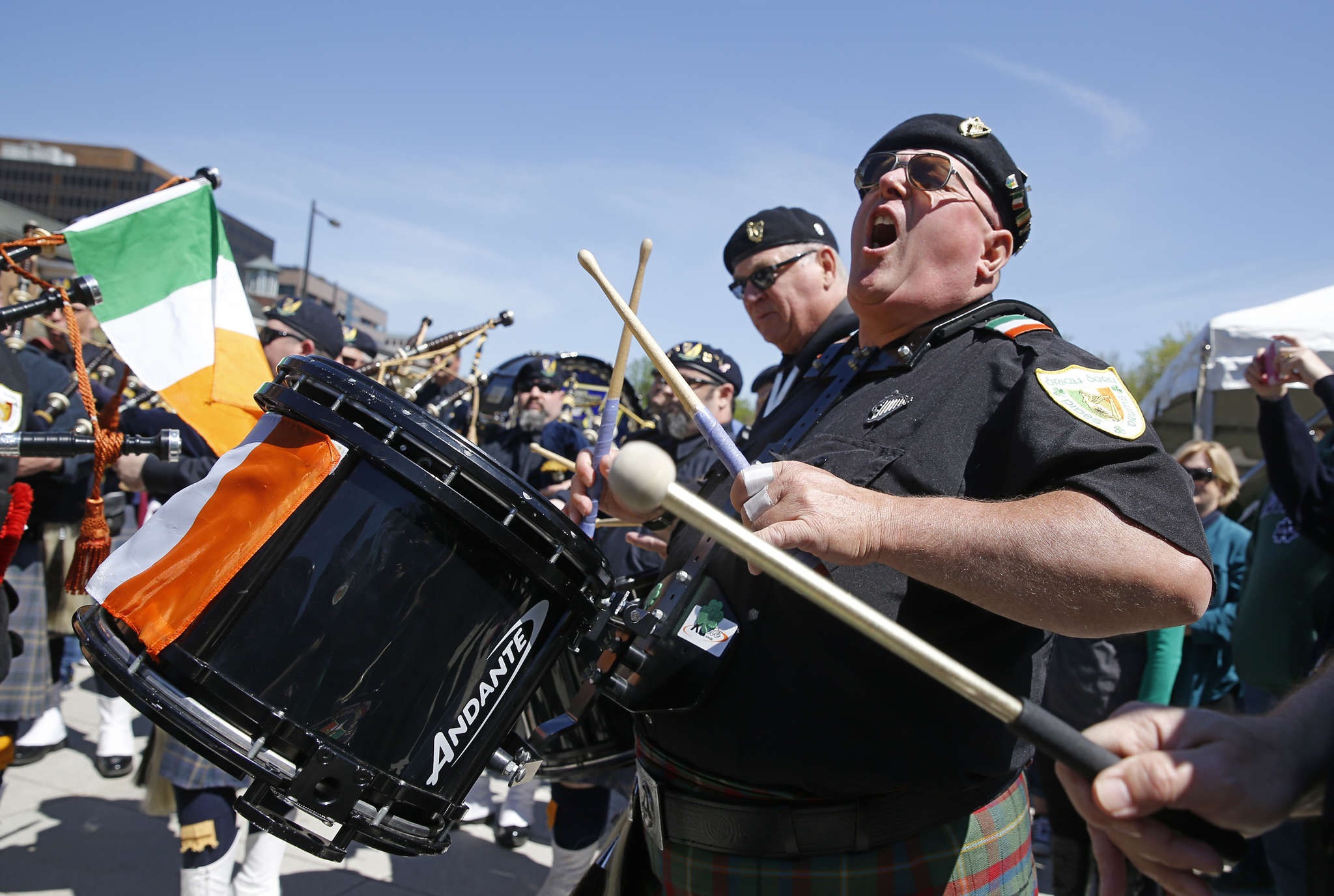 Dan Loftus, a drummer for the Brian Boru Pipes and Drums of Bridgeport, plays in front of Independence Hall.