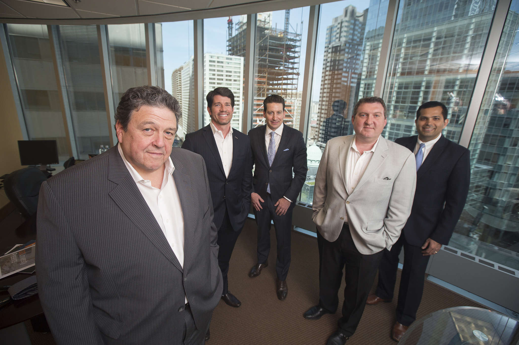 GoldOller´s multifaceted operation includes (from left) Richard S. Oller, Jake Hollinger, Ken Wellar, Benjamin Oller, and Gaurav Gambhir. GoldOller Real Estate Investments is valued at $1.5 billion-plus after just a few years in the making. Rentals and condos make up just part of the business.