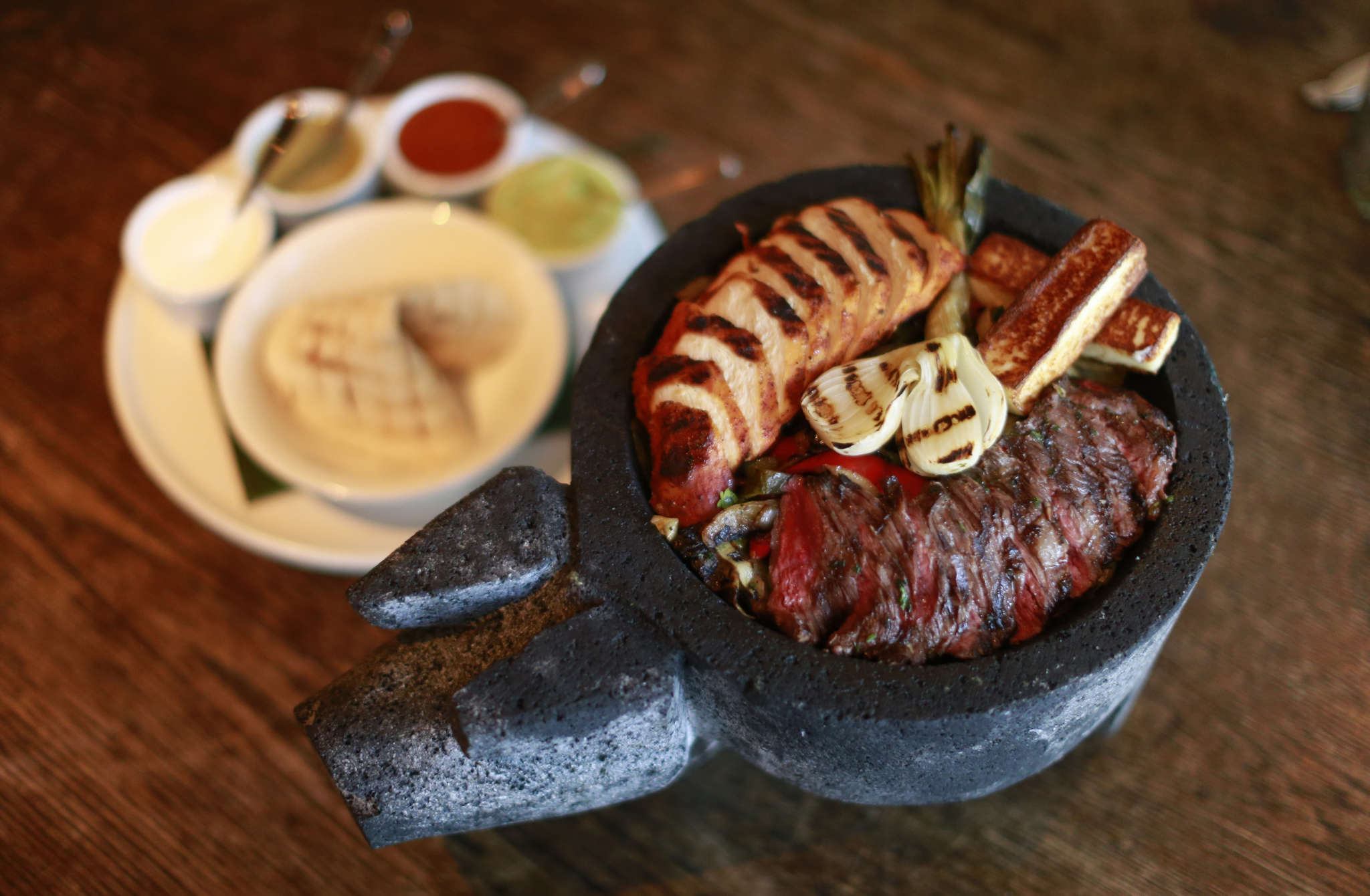 "Craig LaBan´s favorite dish at El Vez is a giant molcajete filled with peppers, onions, and ""al carbon"" grilled guajillo-marinated skirt steak and achiote chicken."