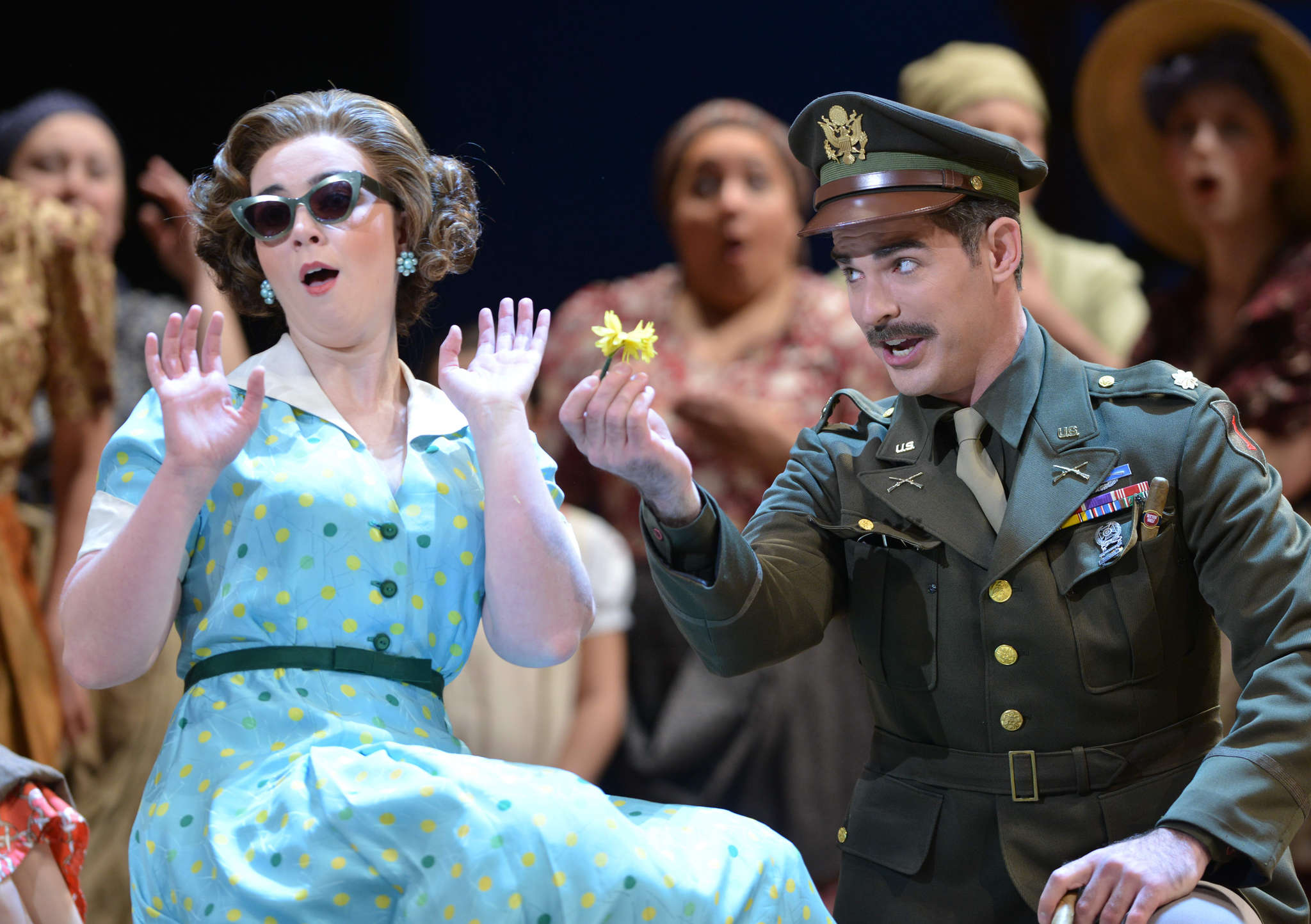 """Sarah Shafer , as Adina, tries to resist the charms of Craig Verm, as Sergeant Belcore, in """"L´elisir d´amore."""" Kelly & Massa for Opera Philadelphia"""